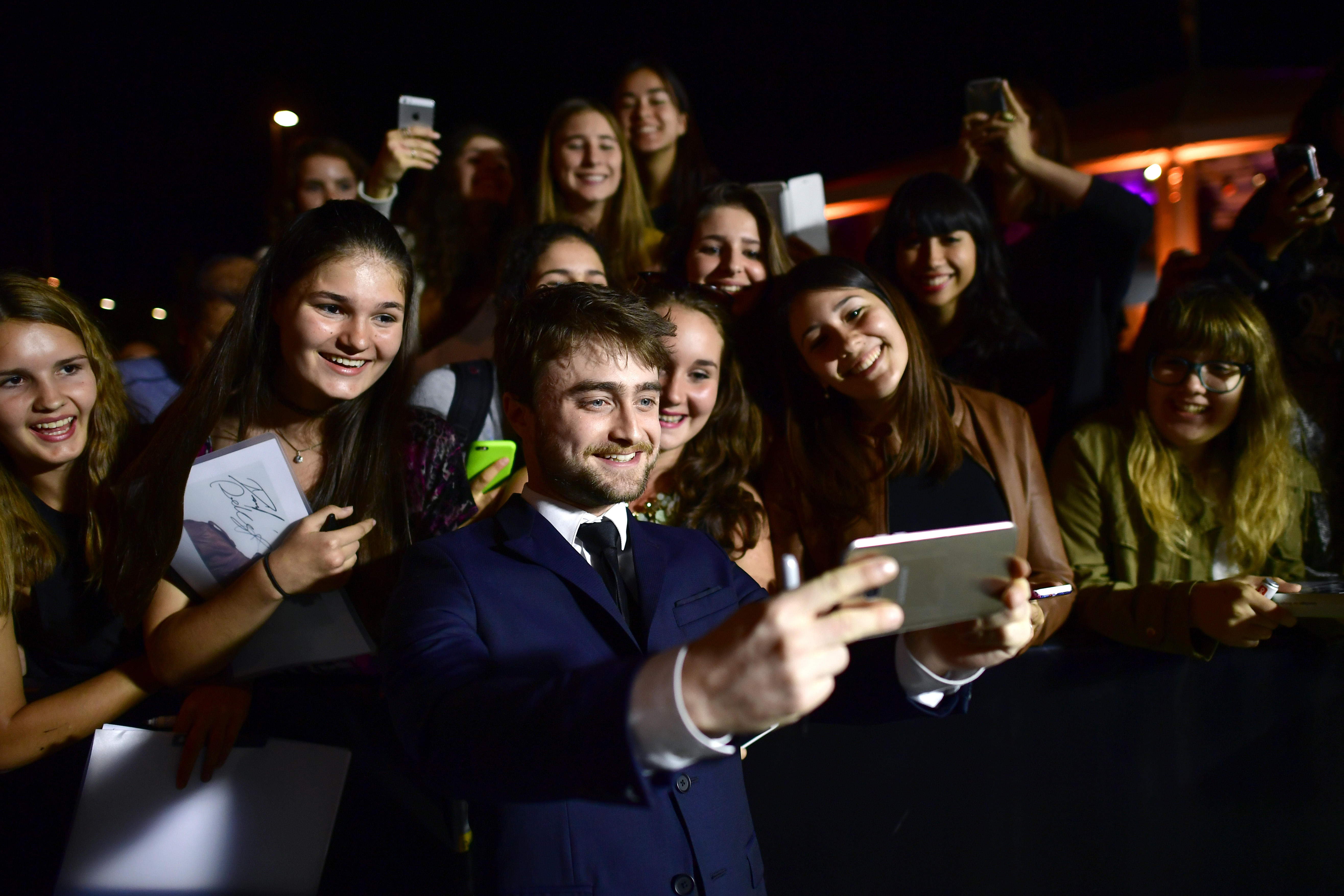 Daniel Radcliffe writes autographs and takes selfies with fans as he attends the 'Imperium' premiere during the 12th Zurich Film Festival on September 30, 2016 in Zurich, Switzerland.