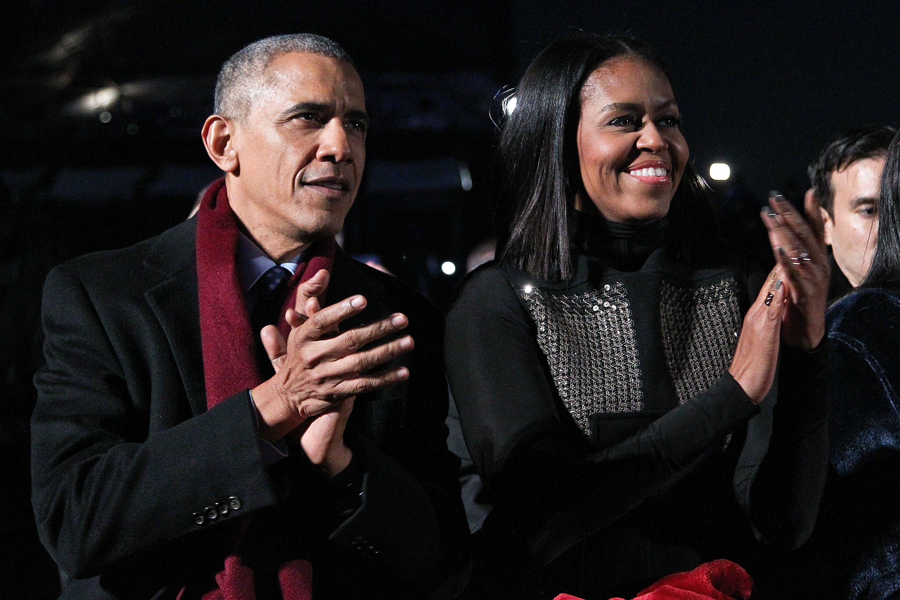 WASHINGTON, DC - DEC. 1 2016:  President Barack Obama sits with first lady Michelle Obama to watch musical performances during the 94th Annual National Christmas Tree Lighting Ceremony