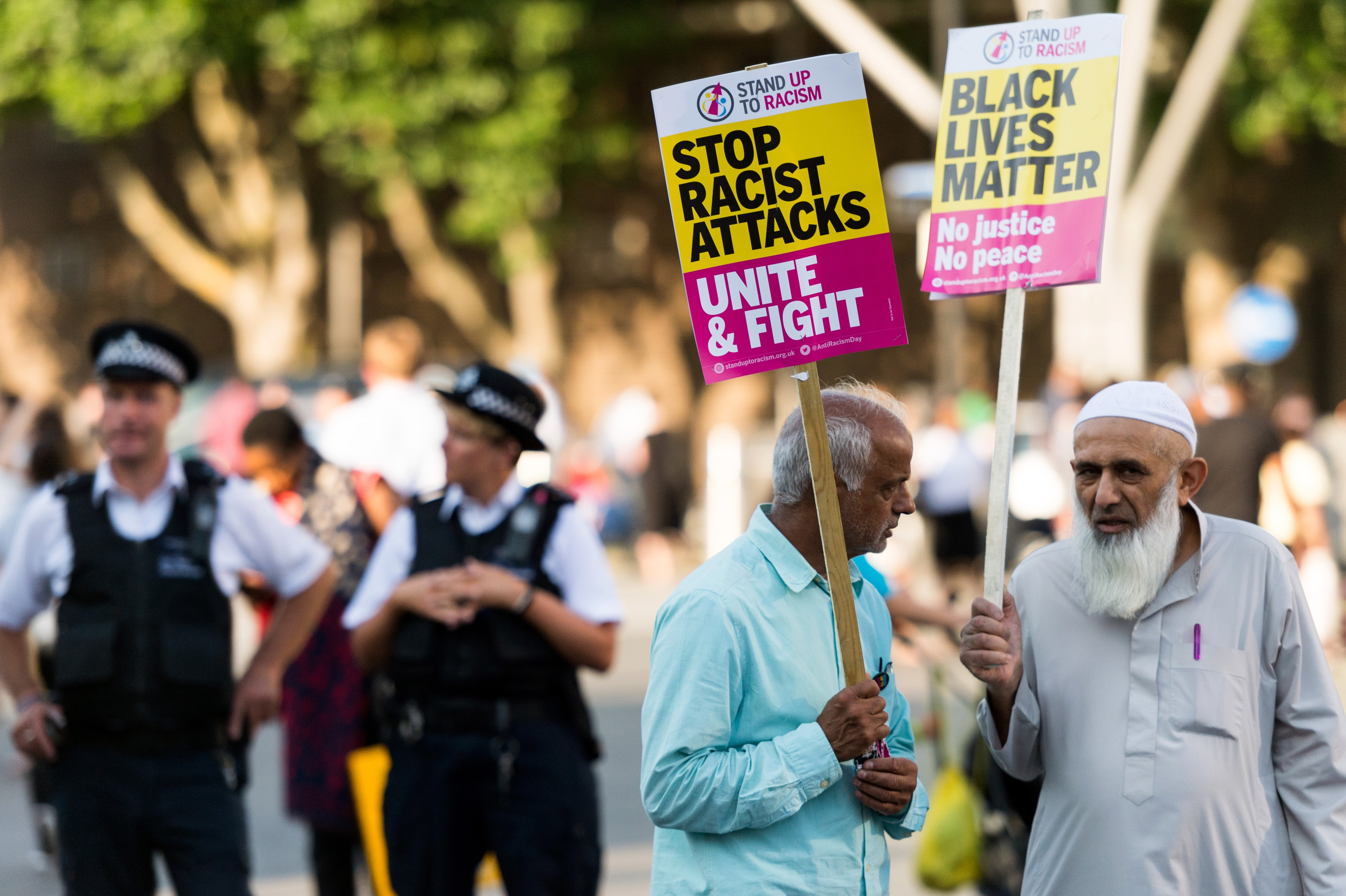 Protesters hold banners reading  Black Lives Matter - No Justice, No Peace - Stop Racist Attacks - Unite And Fight  at a vigil for Resham Khan and Janeel Muhktar who were attacked with sulphuric acid in London, United Kingdom on July 05, 2017.