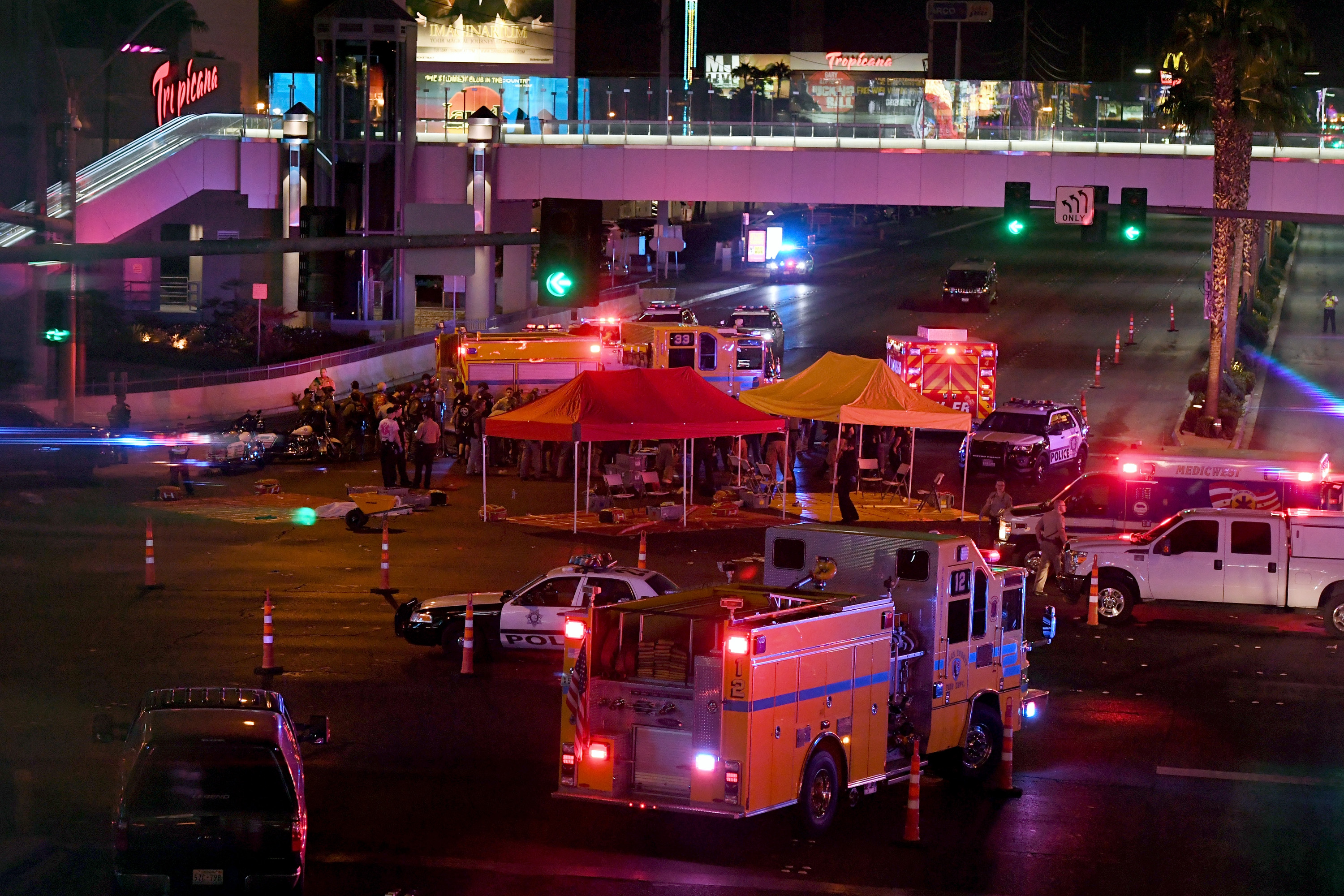 Police and rescue personnel gather at the intersection of Las Vegas Boulevard and Tropicana Ave. after a mass shooting at a country music festival nearby on Oct. 2, 2017 in Las Vegas, Nevada