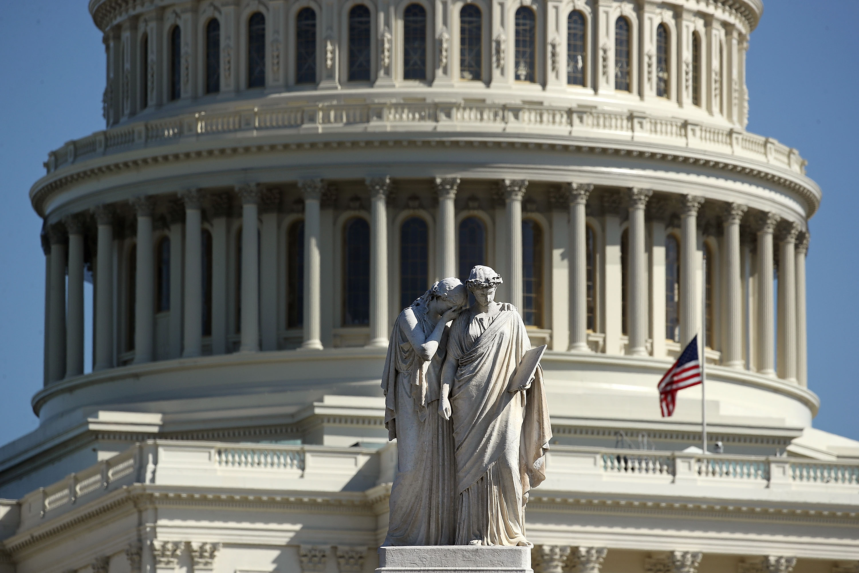 he Peace Monument stands in front of the U.S. Capitol where an American flag flies at half-staff, on October 2, 2017 in Washington, DC.