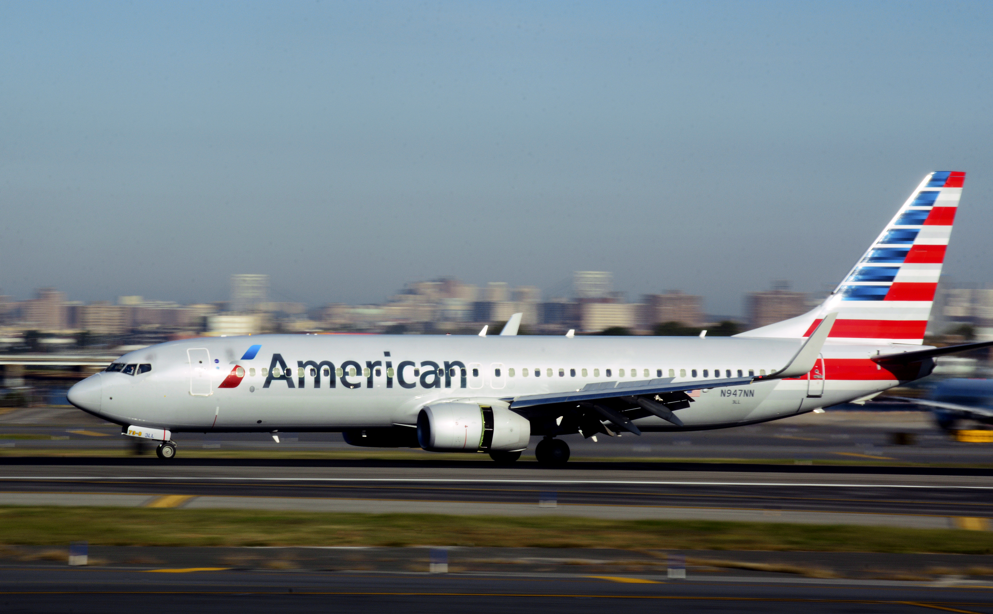NEW YORK, NY - OCT. 4, 2017:  An American Airlines passenger jet (Boeing 737) lands at LaGuardia Airport in New York, New York.