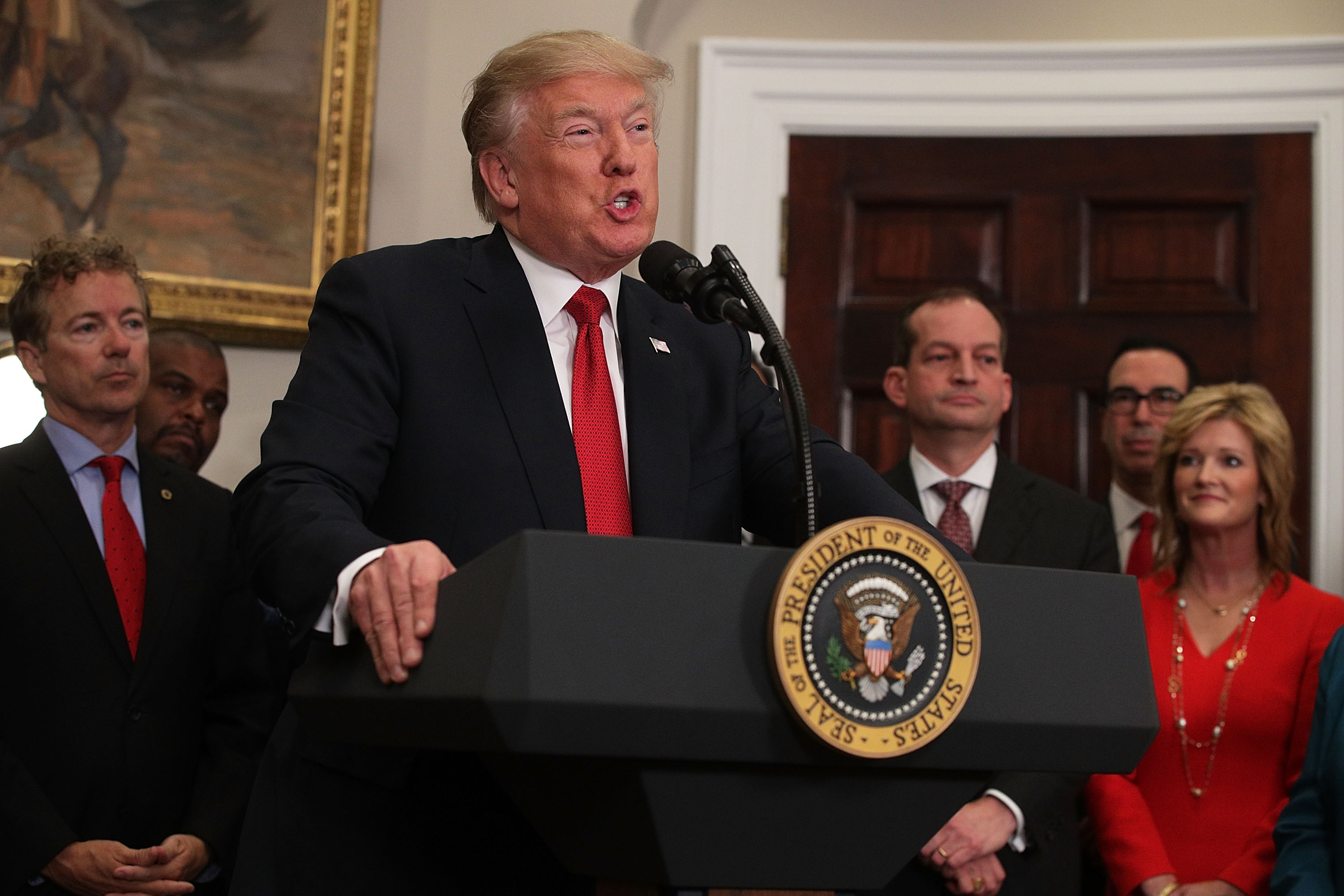 WASHINGTON, DC - OCTOBER 12:  U.S. President Donald Trump speaks as Sen. Rand Paul (R-KY) (L), Secretary of Labor Alexander Acosta (3rd R) and Secretary of the Treasury Steven Mnuchin (2nd R) look on during an event in the Roosevelt Room of the White House October 12, 2017 in Washington, DC. President Trump signed the executive order to loosen restrictions on Affordable Care Act  to promote healthcare choice and competition.   (Photo by Alex Wong/Getty Images)