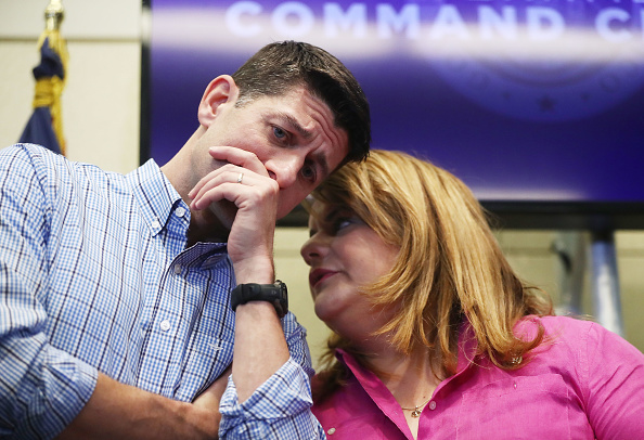 U.S. House Speaker Paul Ryan (R-WI), L, speaks with U.S. Rep. Jenniffer Gonzalez-Colon (R-PR) at a press conference on October 13, 2017 in San Juan, Puerto Rico.