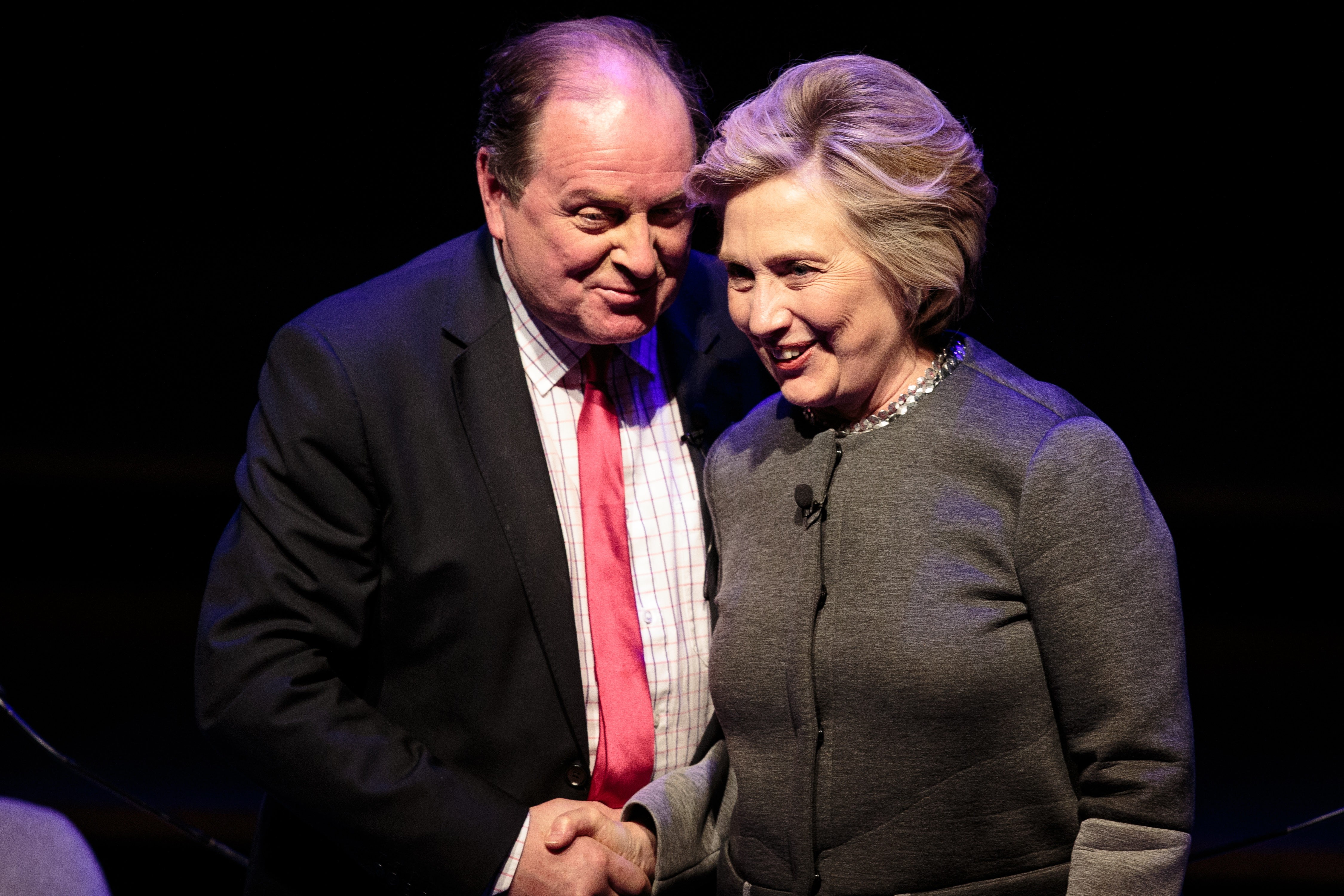 Hilary Clinton (R) shakes hands with broadcaster James Naughtie (L) following her talk at the London Literary Festival at The Royal Festival Hall on October 15, 2017 in London, England.