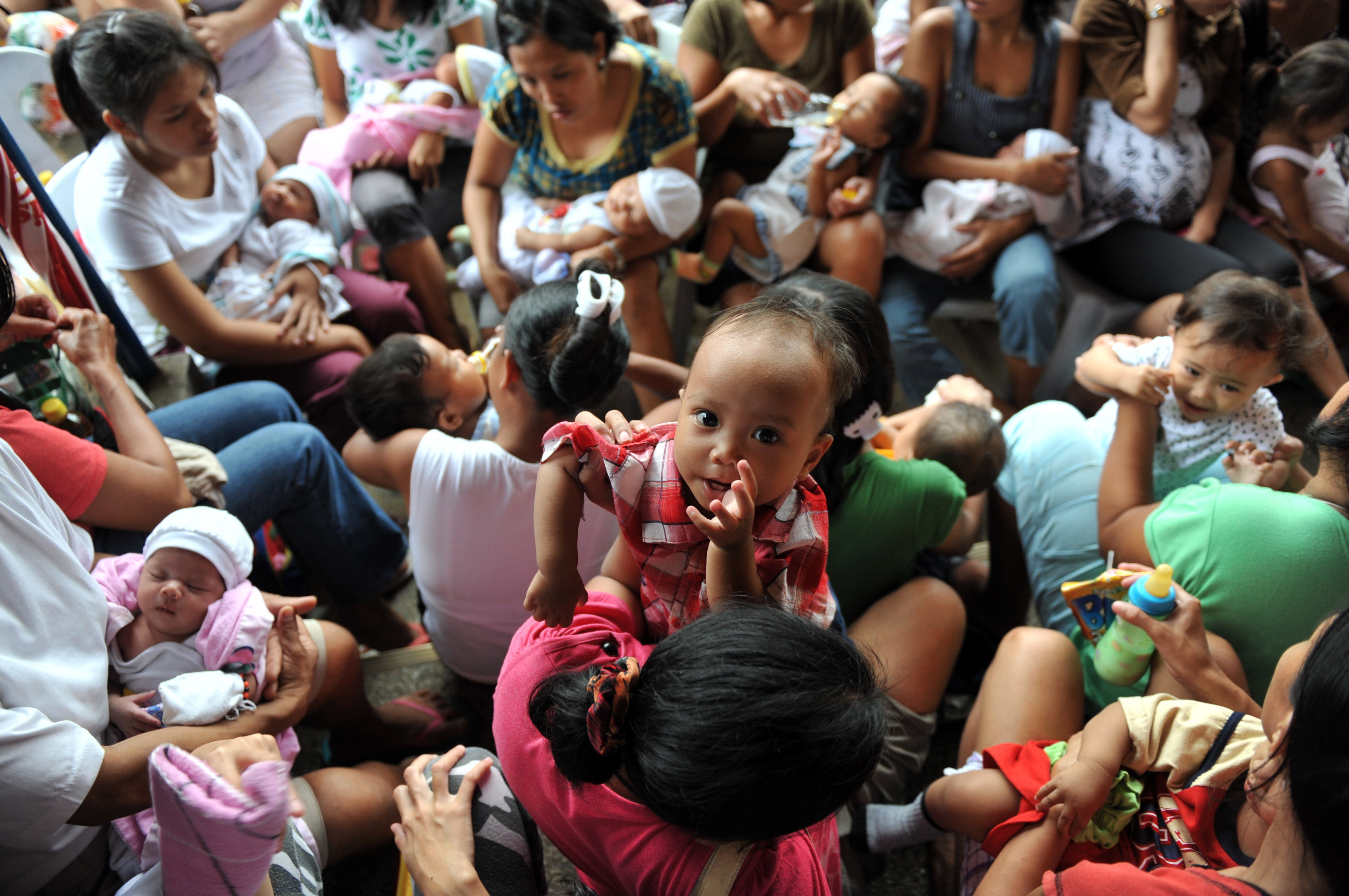 Pregnant women affected by floods wait for a check-up organized by the United Nations Population Fund (UNFPA) in Cainta, Philippines on Oct.8, 2009.