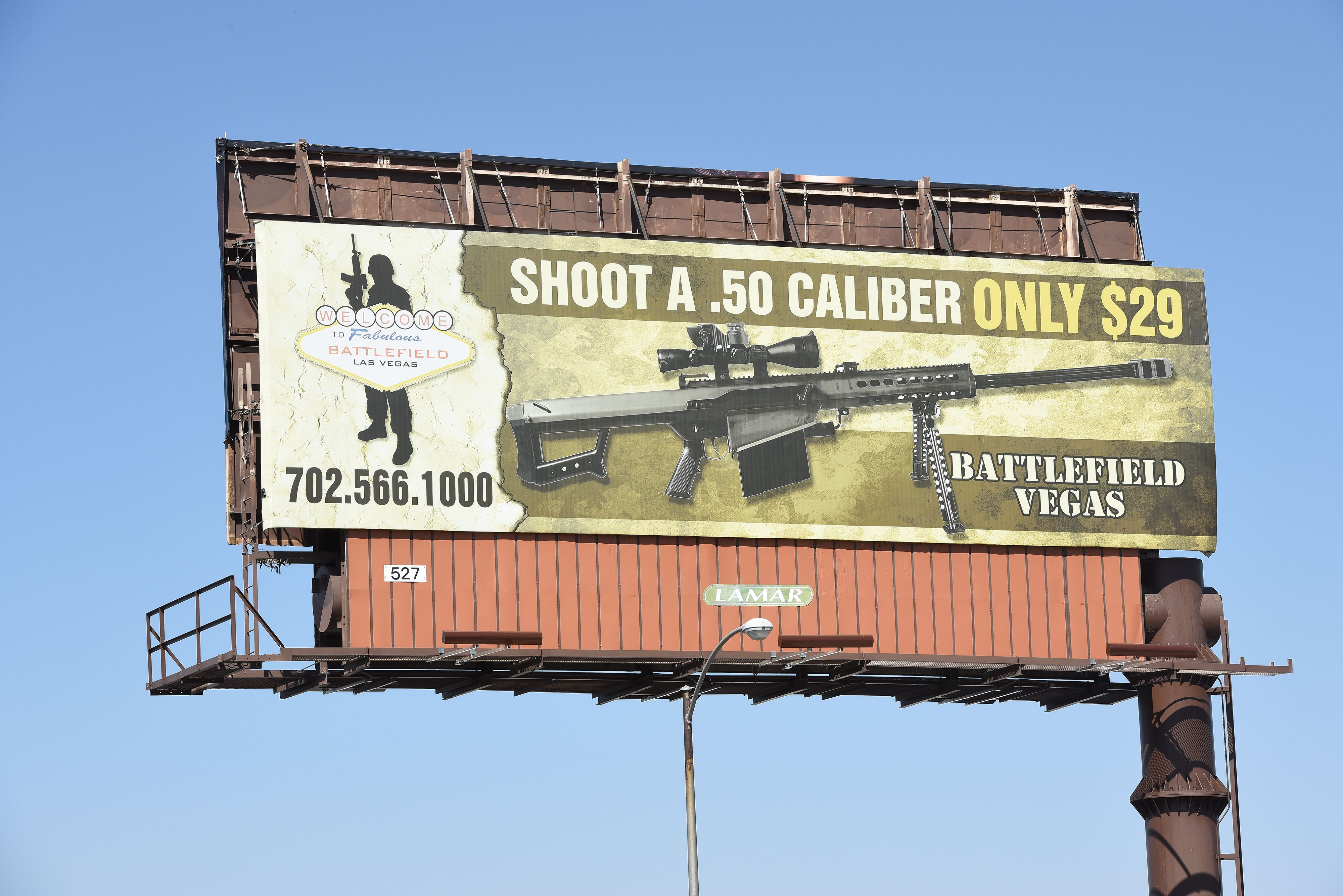 A billboard advertises a gun shooting range in Las Vegas, Nevada on October 4, 2017.