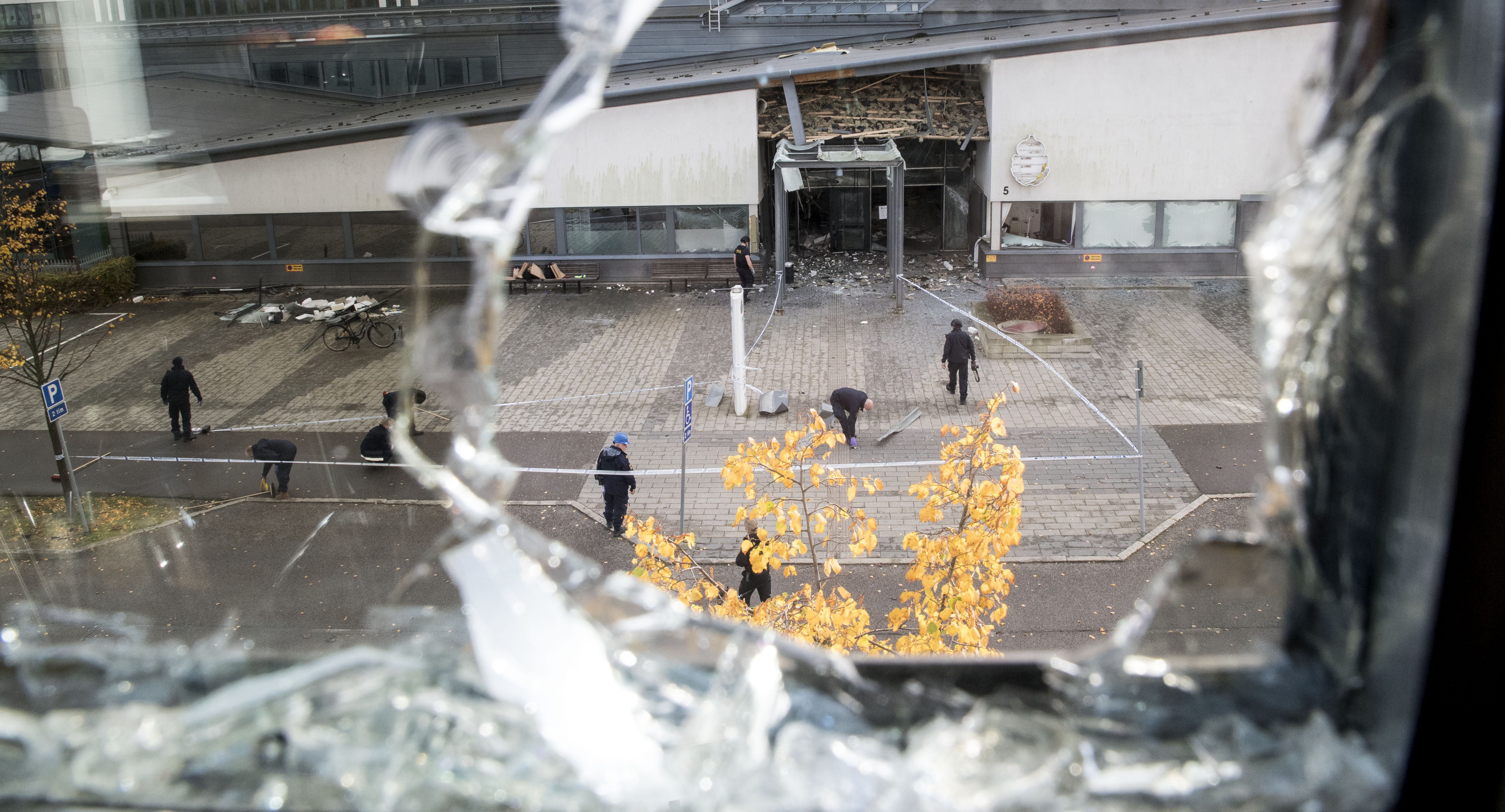 Police search for evidence in a cordoned area surrounding the police station in Helsingborg, Sweden, on Oct. 18 2017, after a powerful explosion at the main entrance earlier the same day.