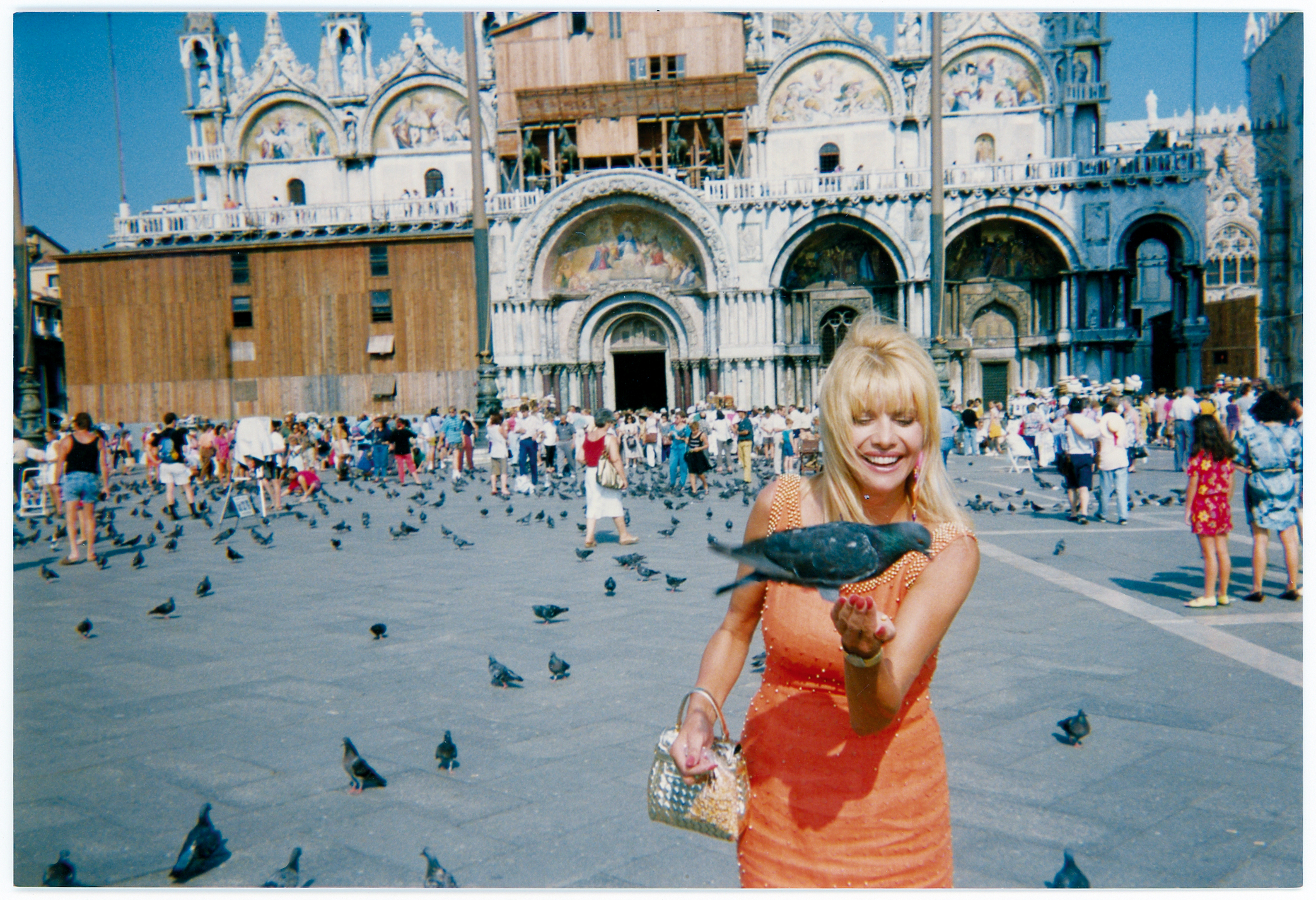 """Making friends                                   with the pigeons in                                   Piazza San Marco,                                   Venice, Italy, circa                                   2005."""