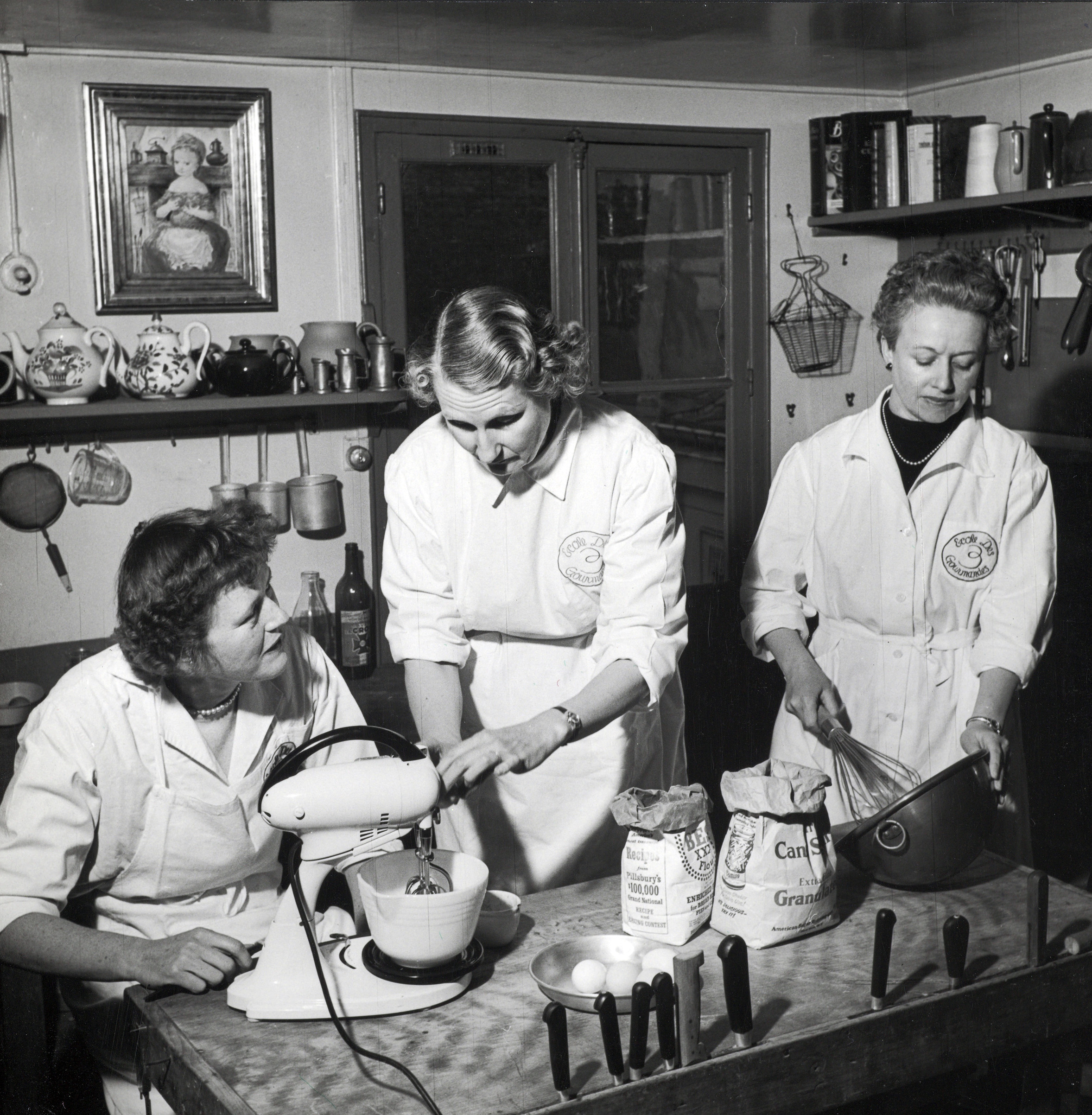 "Les Trois Gourmandes, (aka ""The School of Hearty Eaters""), Julia, Simca, and Louisette, 81 Rue de l'Université, 1953."