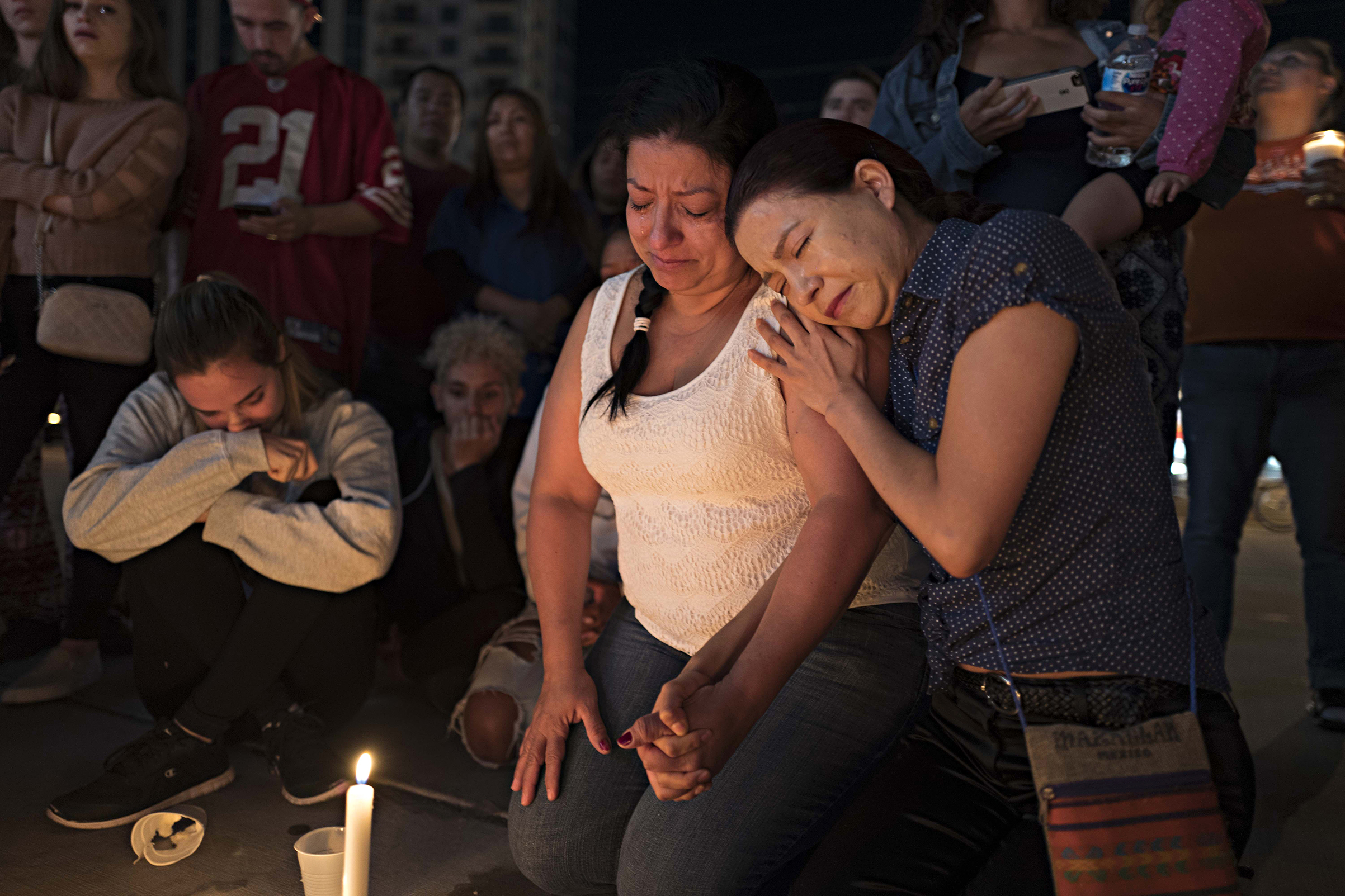 Two women comfort one another at a street vigil, held for victims of the Las Vegas mass shooting, at a main intersection on Las Vegas Boulevard on Oct. 2, 2017.
