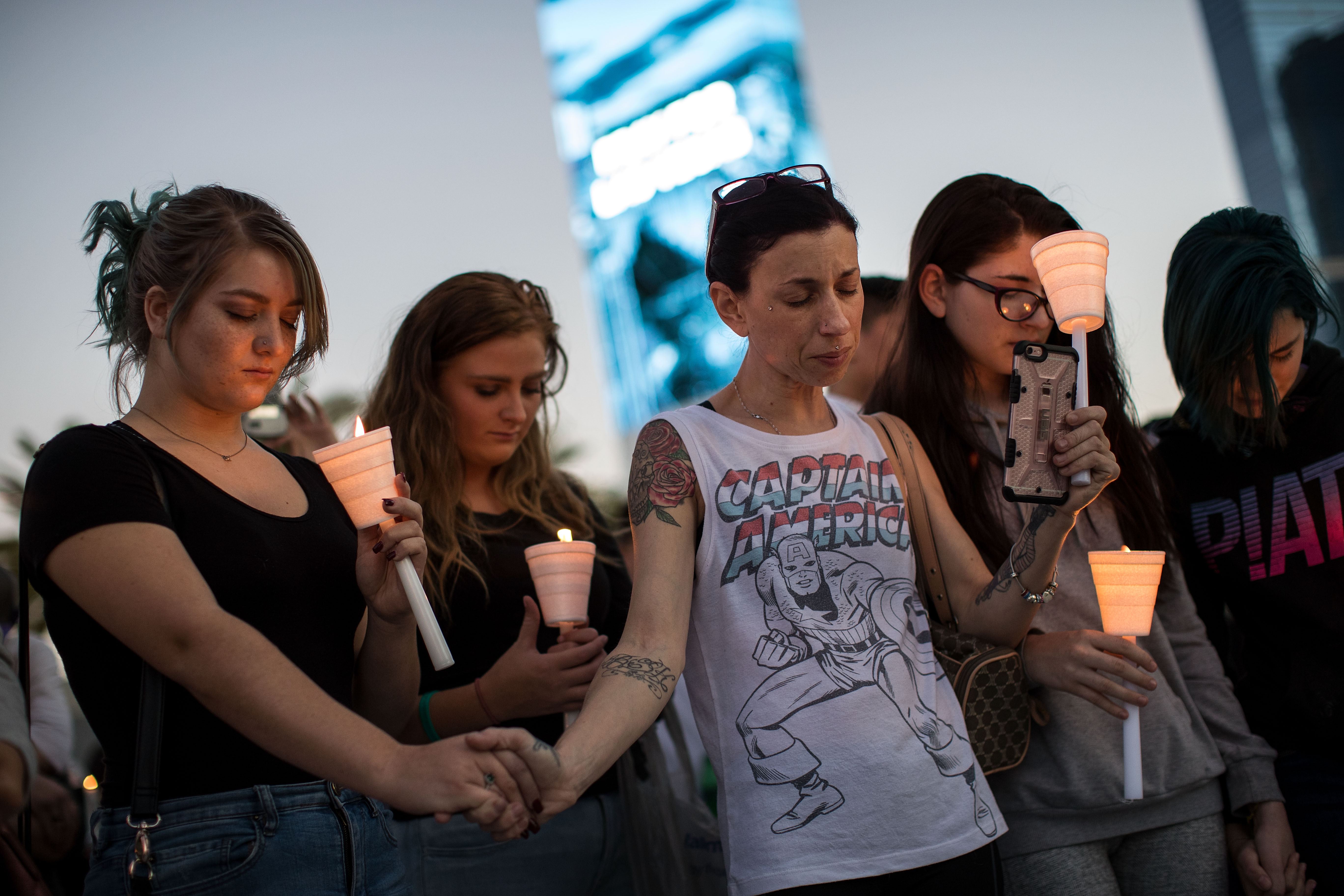 Mourners attend a candlelight vigil at the corner of Sahara Avenue and Las Vegas Boulevard  for the victims of Sunday night's mass shooting, October 2, 2017 in Las Vegas, Nevada.