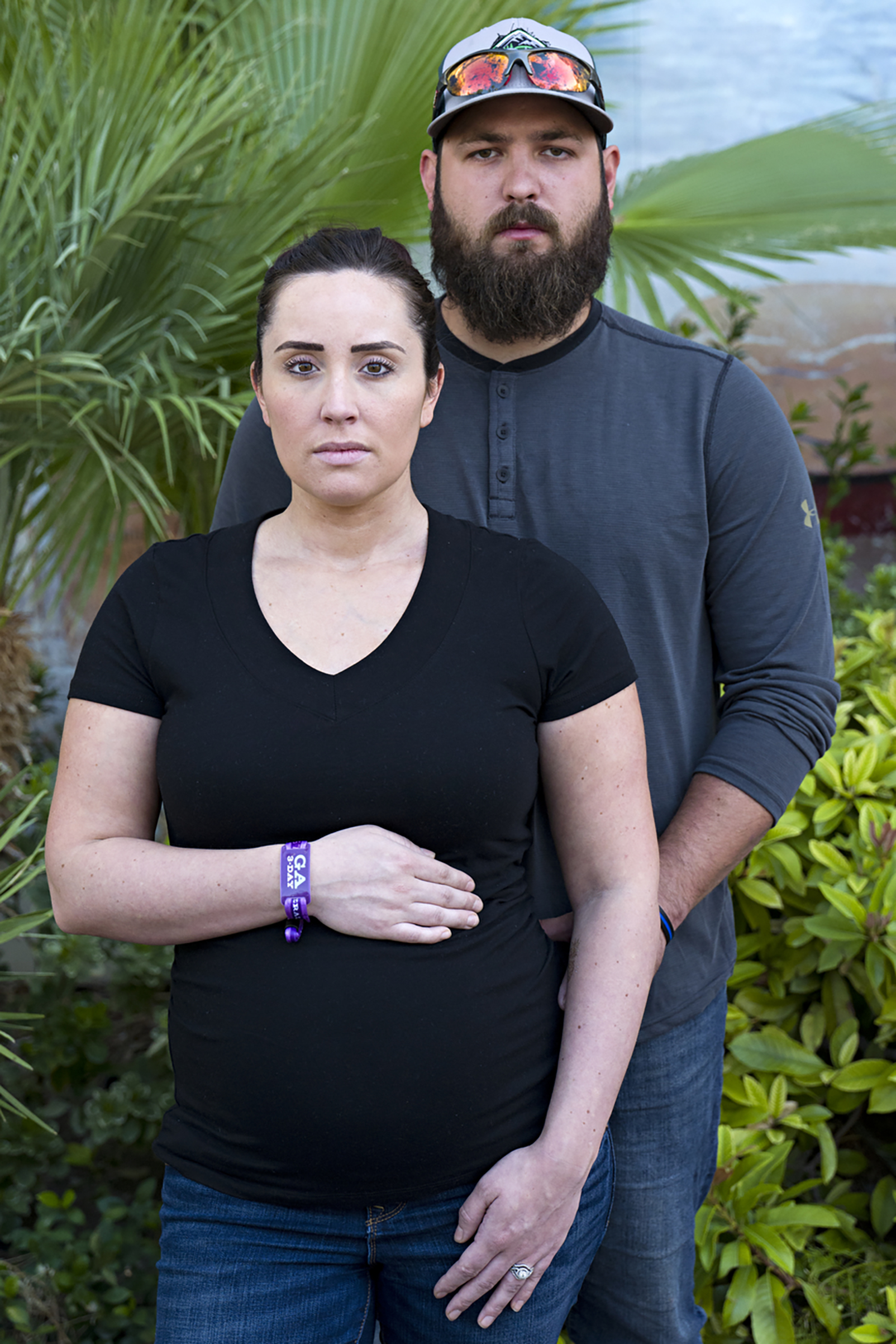 Survivors of the mass shooting, Kelsey Clark eight-months pregnant poses for a portrait with her husband Toby Clark, Las Vegas, Oct. 3, 2017.