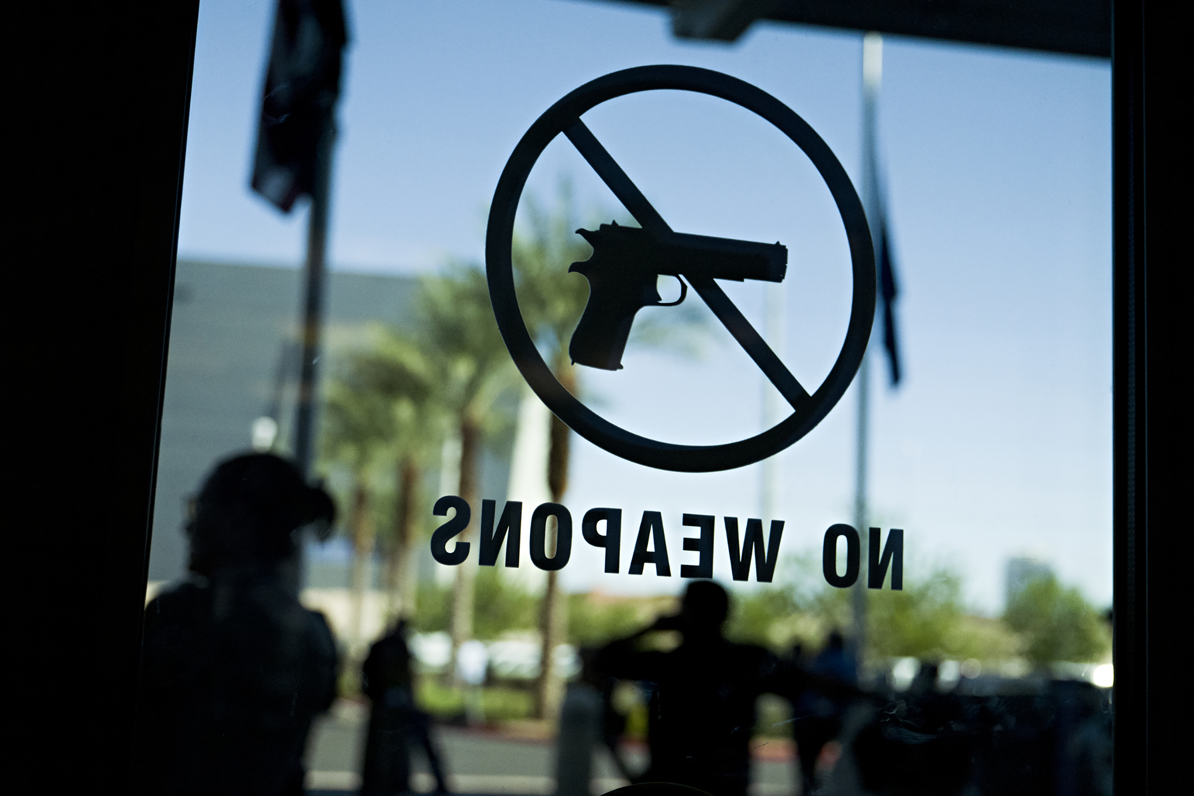A  no Weapons  sign on a door of the Las Vegas Metropolitan Police Department headquarters.