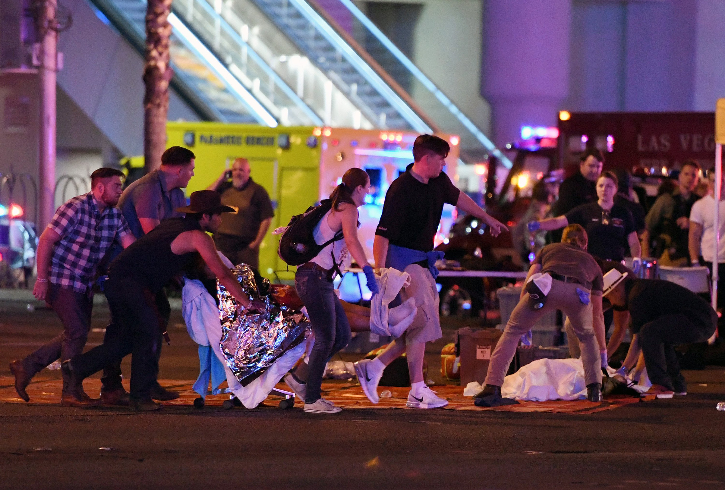 An injured person is tended to after a mass shooting at the Route 91 Harvest country music festival on Oct. 1, 2017 in Las Vegas.