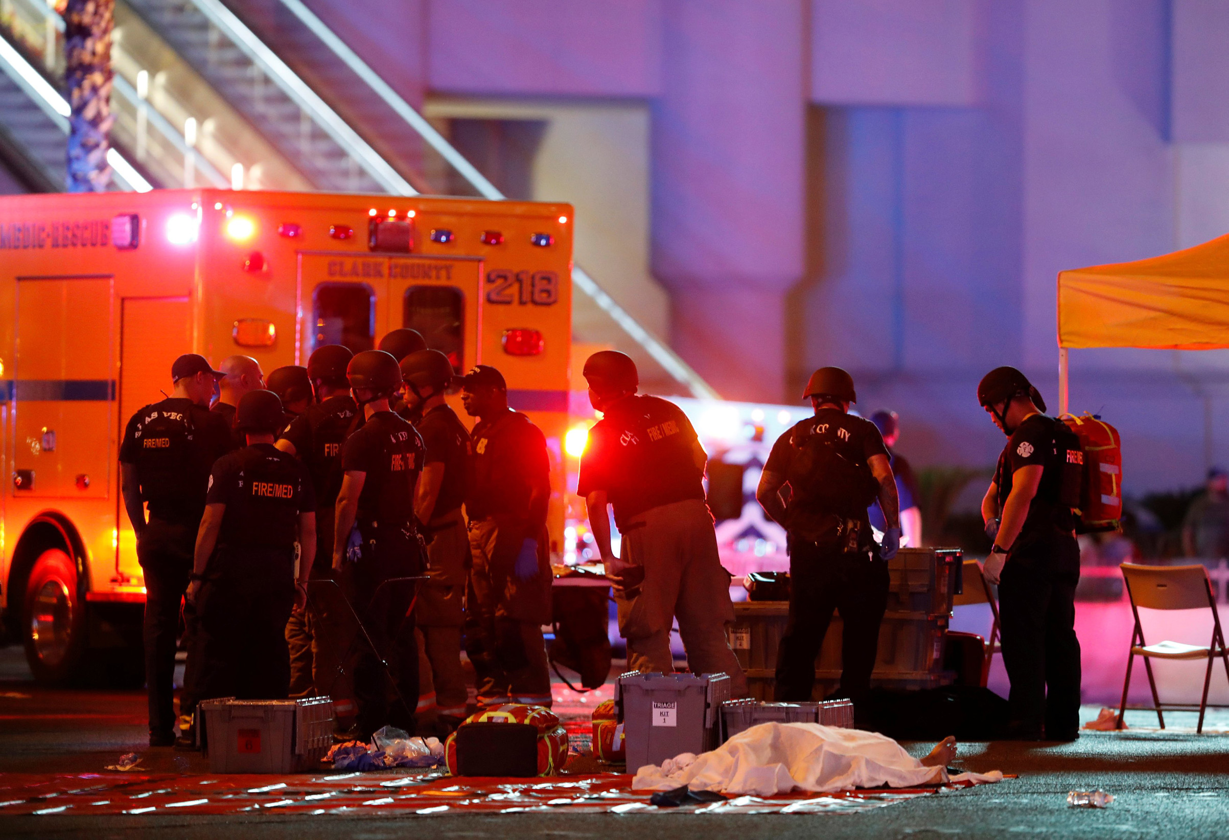A body is covered with a sheet at the intersection of Tropicana Avenue and Las Vegas Boulevard South after a mass shooting at a music festival on Oct. 1, 2017 in Las Vegas.