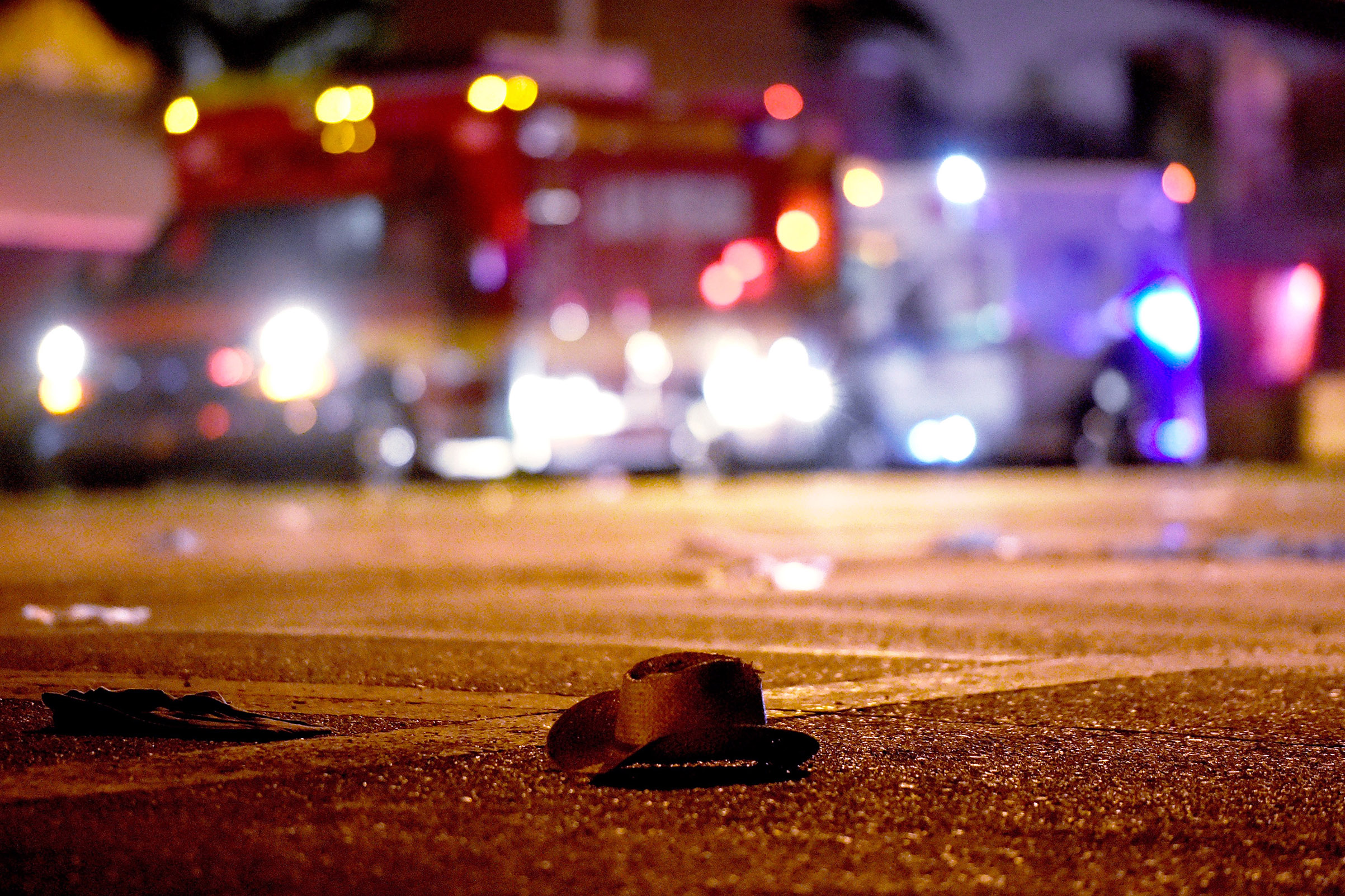 A cowboy hat lays in the street after shots were fired at the Route 91 Harvest country music festival after a shooting, Oct. 1, 2017 in Las Vegas.