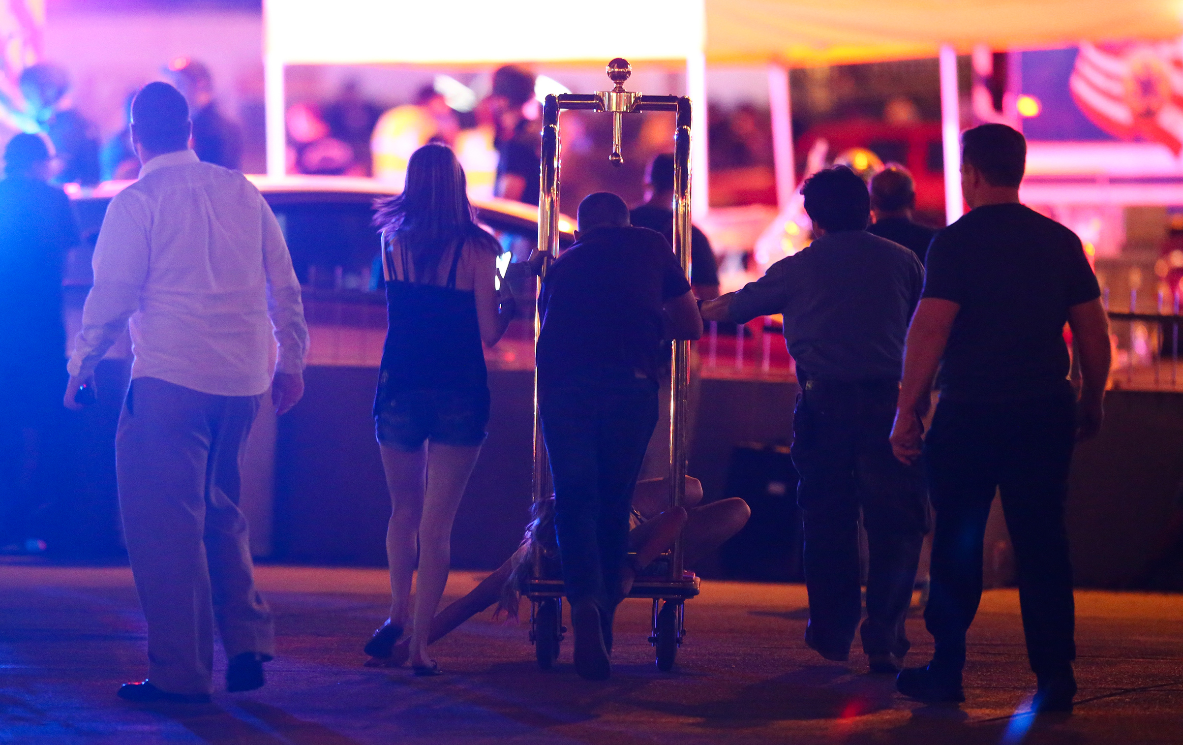 A wounded woman is moved outside the Tropicana during an active shooter situation on the Las Vegas Strip in Las Vegas Sunday, Oct. 1, 2017.