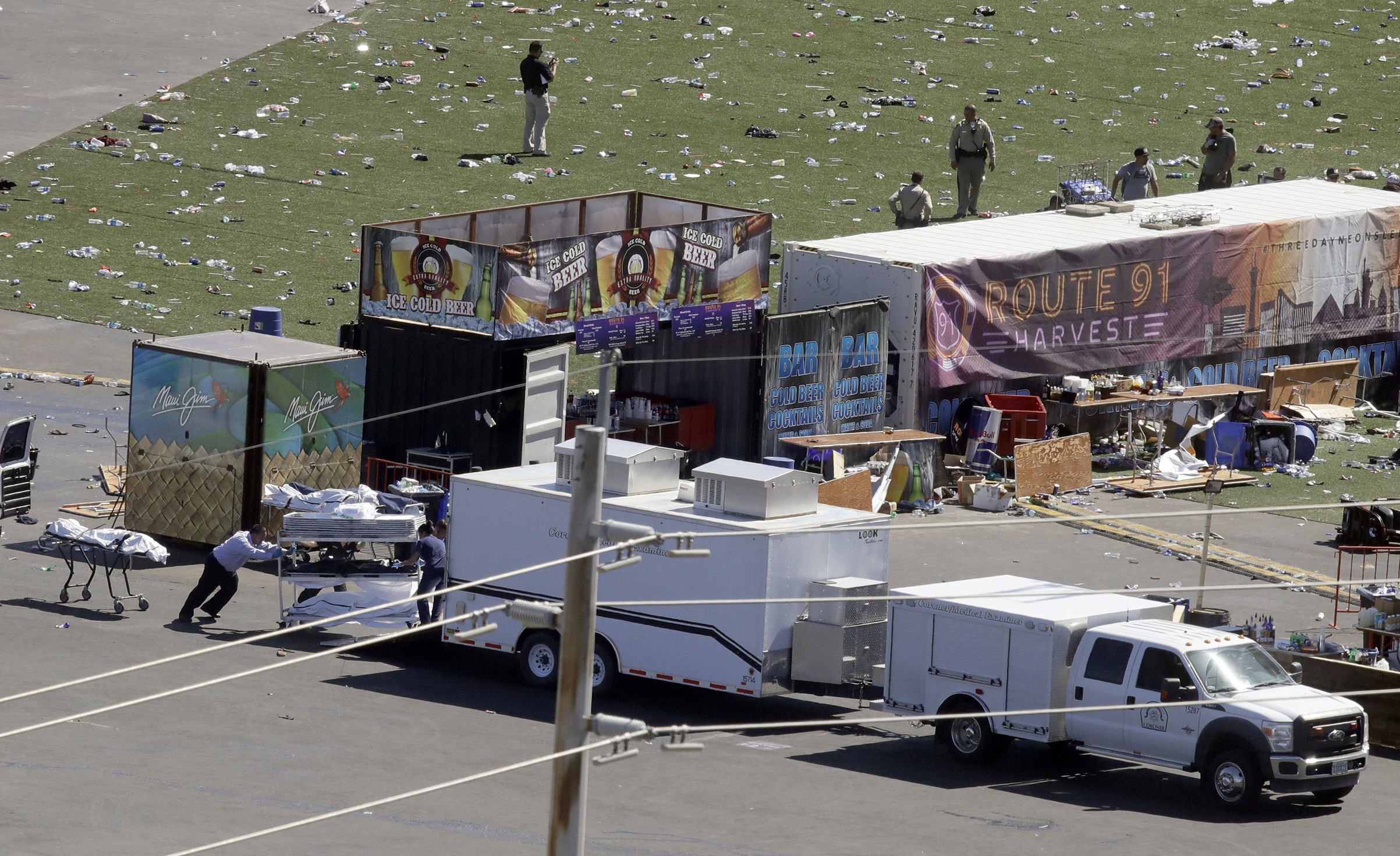 Investigators load a truck with bodies from the scene of a mass shooting at a music festival near the Mandalay Bay resort and casino on the Las Vegas Strip, in Las Vegas on Oct. 2 2017.