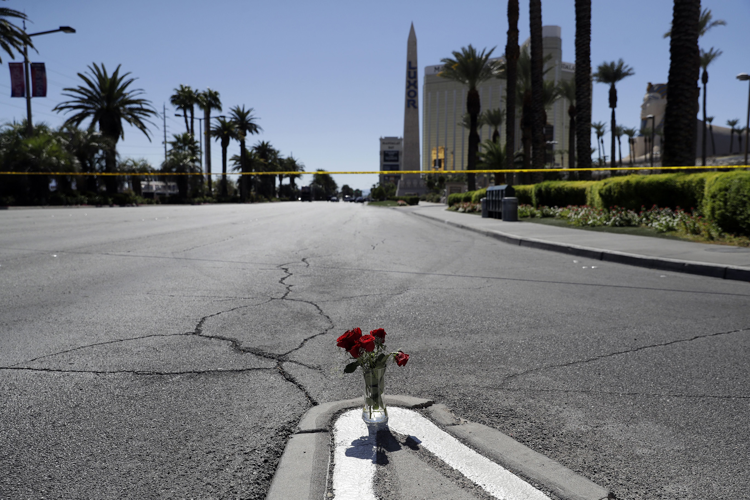Flowers are placed near the scene of a mass shooting, that occurred at a music festival near the Mandalay Bay resort in Las Vegas on Sunday Oct. 2, 2017.