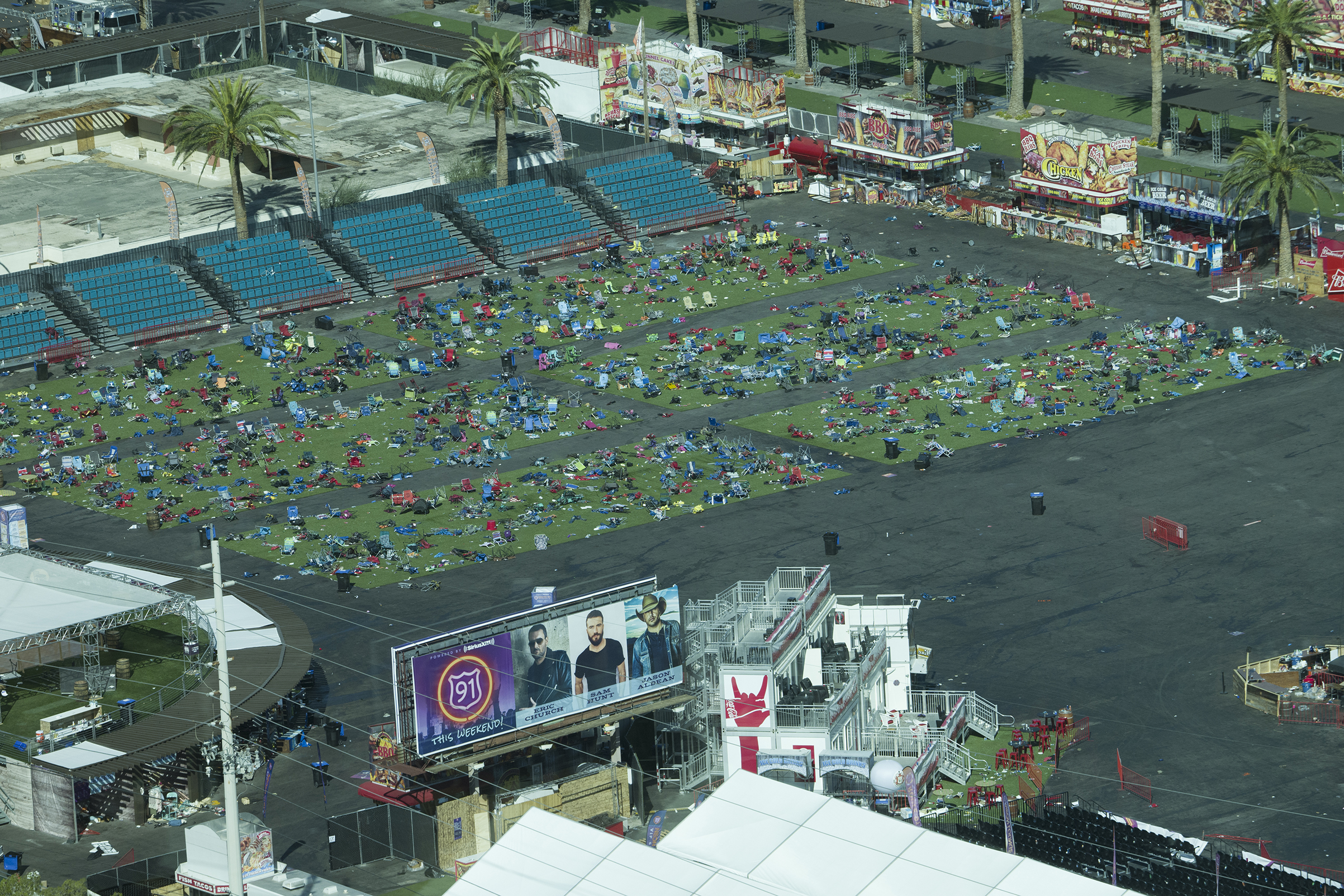 View of the festival grounds showing scattered belongings and chairs, left behind at the site of the mass shooting, Oct. 3, 2017.