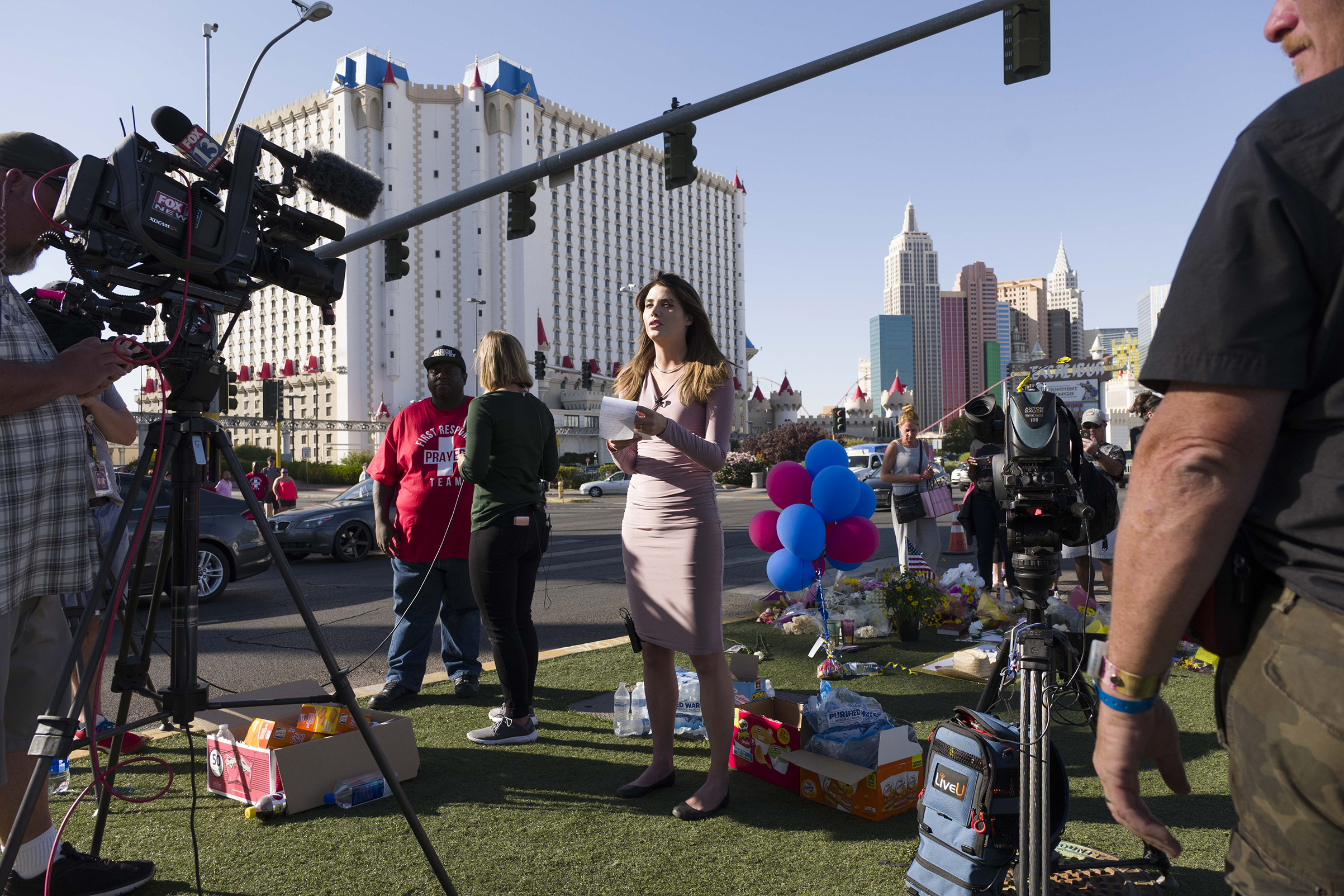 Members of the media reporting on the mass shooting, near the  Mandalay Bay Hotel and resort, Oct. 4, 2017.