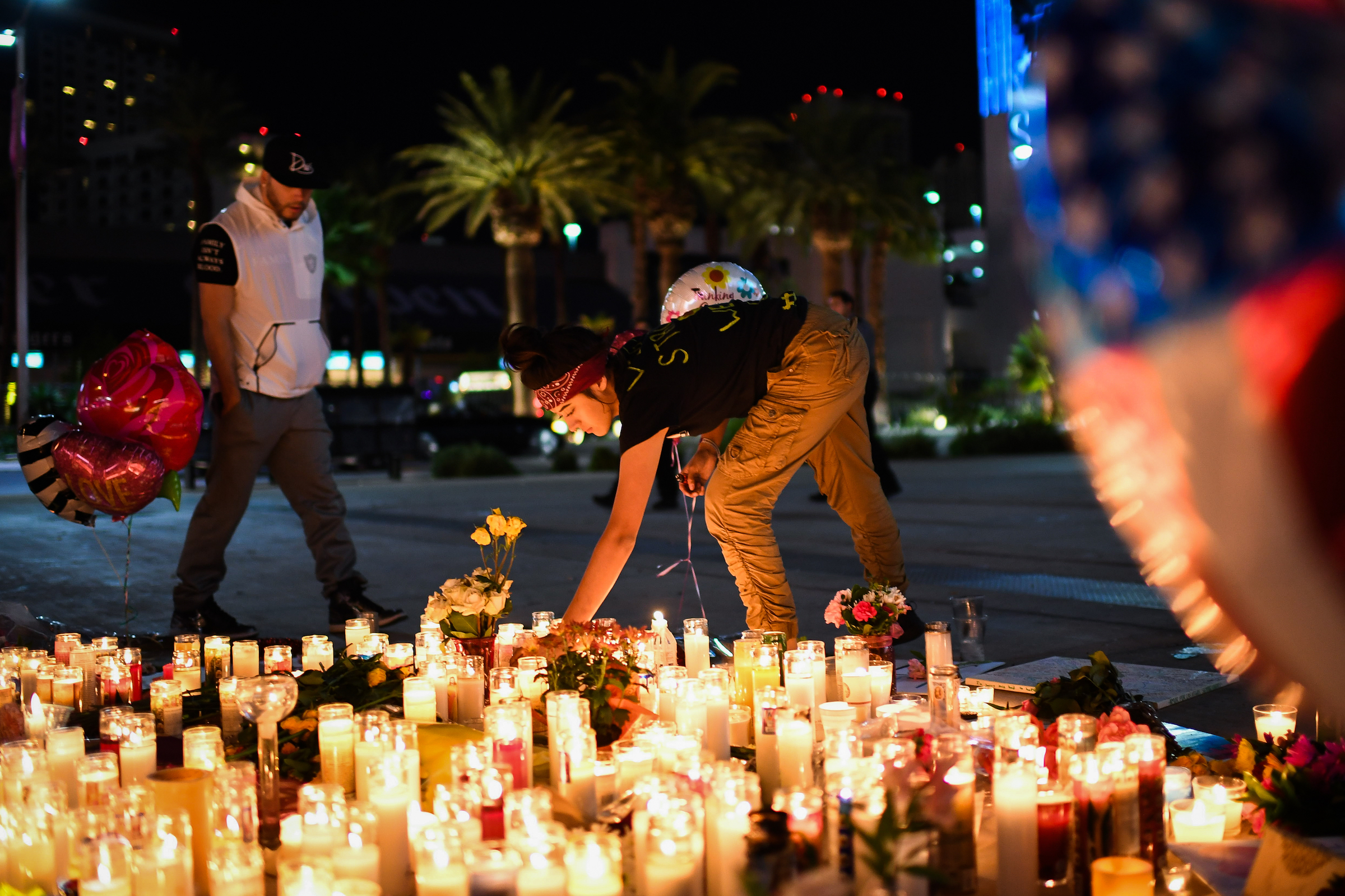 Priscilla Olivas, 19, of Las Vegas, NV, lights up a candle at a street vigil that was held for the victims along the Las Vegas Strip a day after 59 people were killed and more than 500 wounded at the Route 91 Harvest Country Music Festival on Monday, October 2, 2017, in Las Vegas, NV.