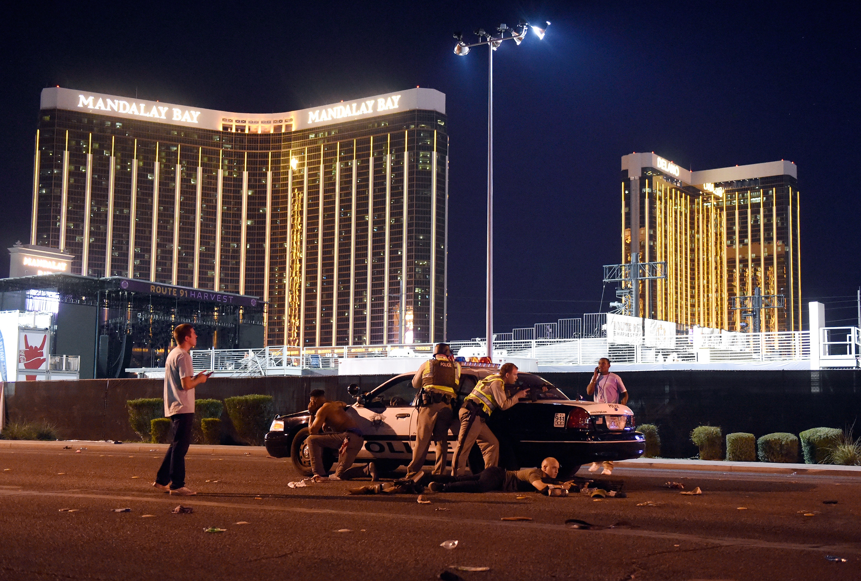 Las Vegas police stand guard along the streets outside the Route 91 Harvest Country music festival groundss of the Route 91 Harvest on October 1, 2017 in Las Vegas.