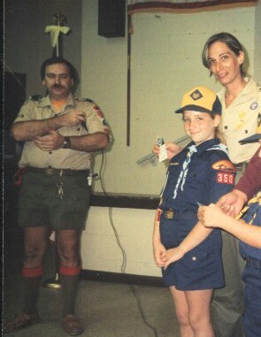 A young Margo Mankes, in Cub Scouts uniform, with her parents