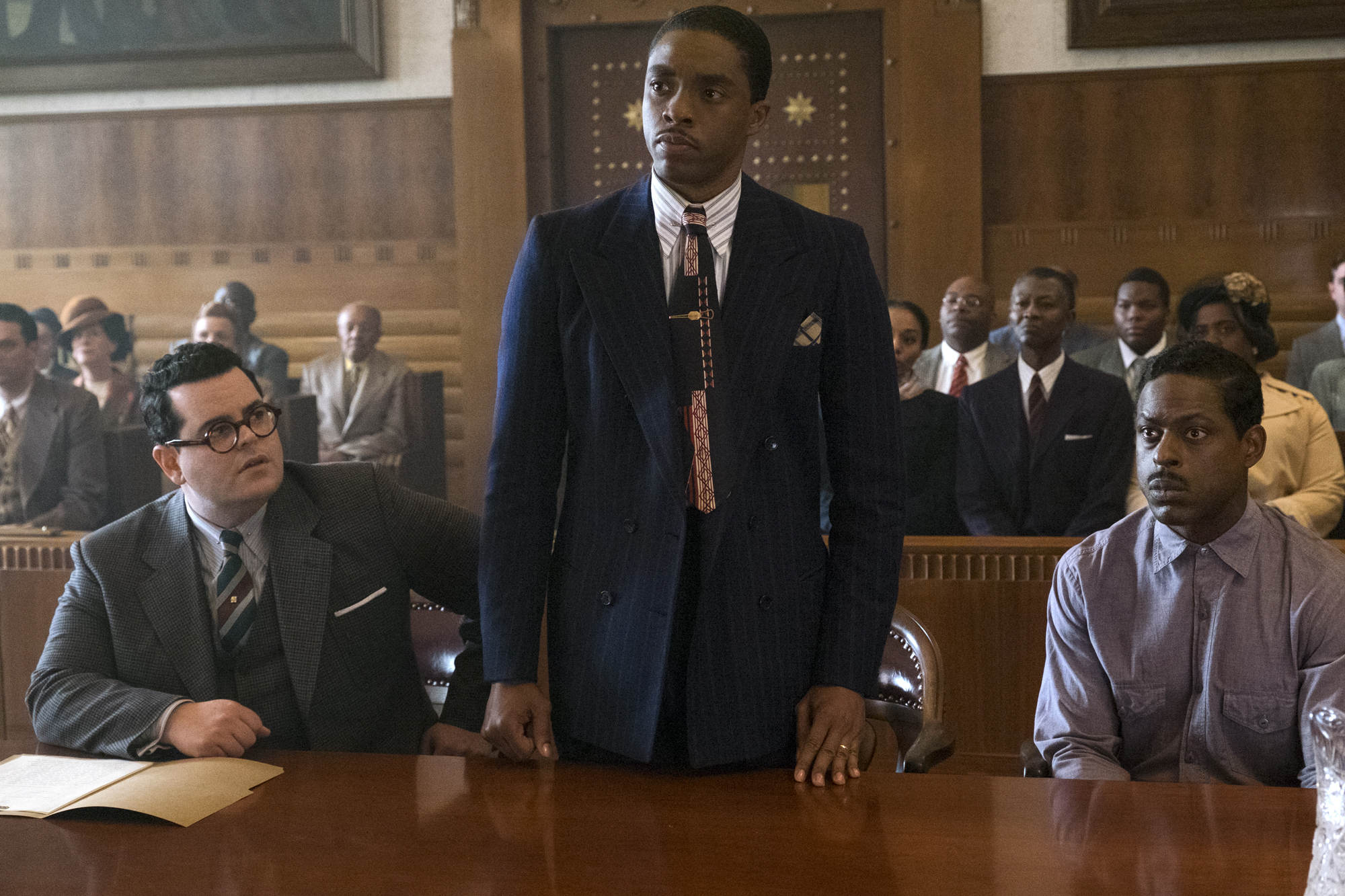 Josh Gad, Chadwick Boseman and Sterling K. Brown in a scene from Marshall