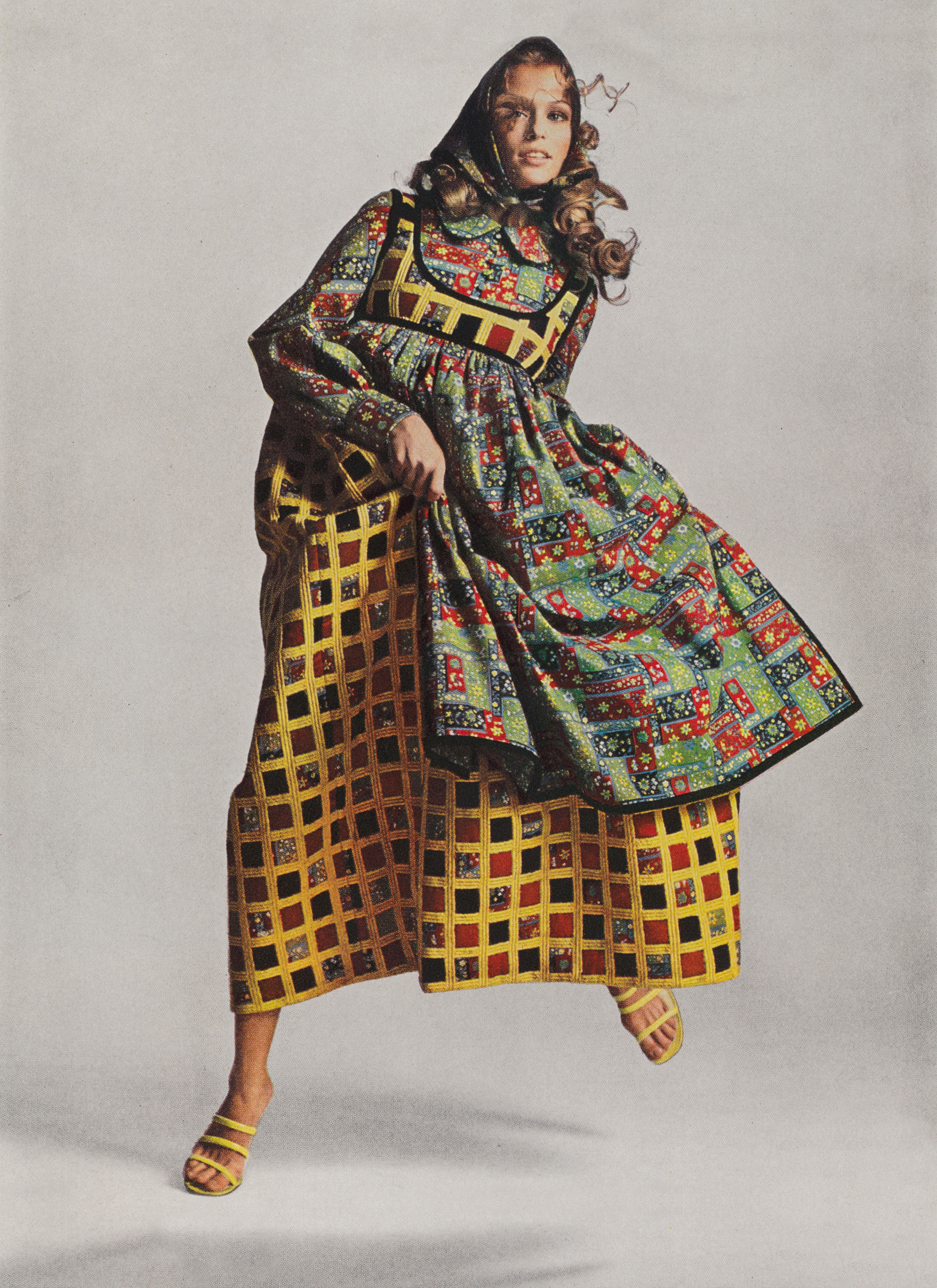 Advertisement for the Cotton Producers Institute featuring a variation on Geoffrey Beene's atypical, Bohemian influenced Fall 1969 Bazaar collection. Published in Harper's Bazaar, September 1969.