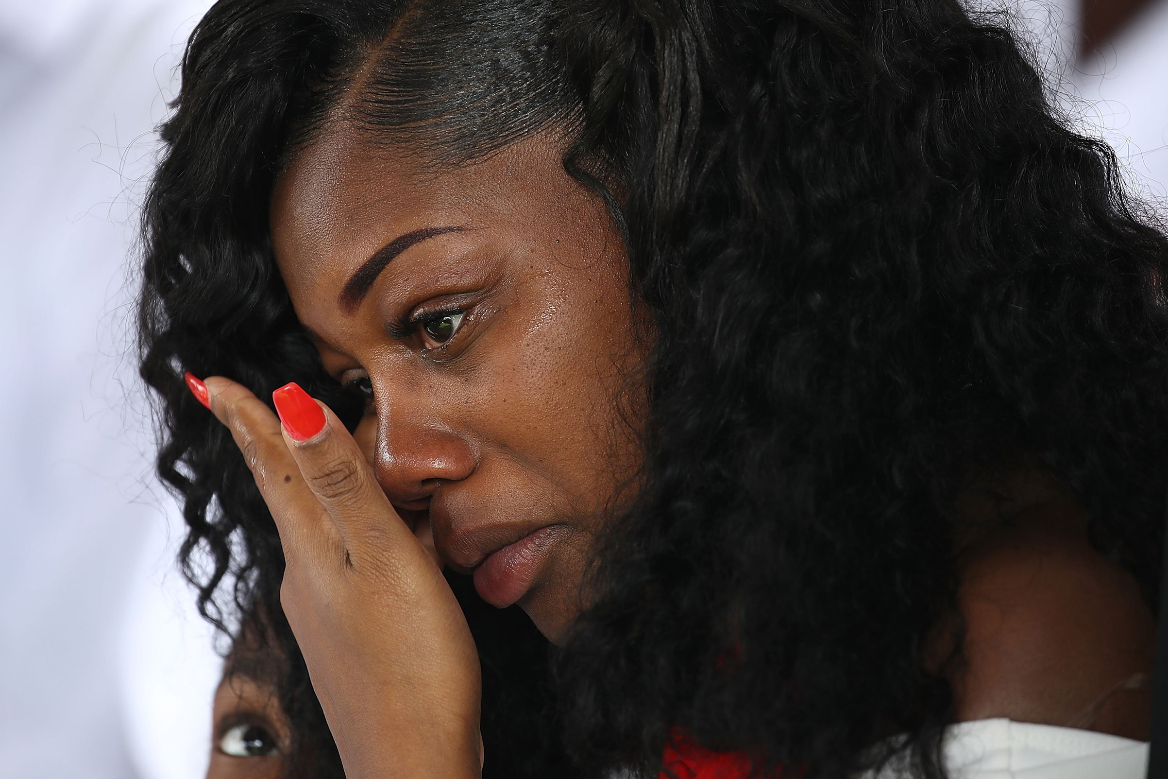 Myeshia Johnson wipes away tears during the burial service for her husband U.S. Army Sgt. La David Johnson at the Memorial Gardens East cemetery on Oct. 21, 2017 in Hollywood, Fla.