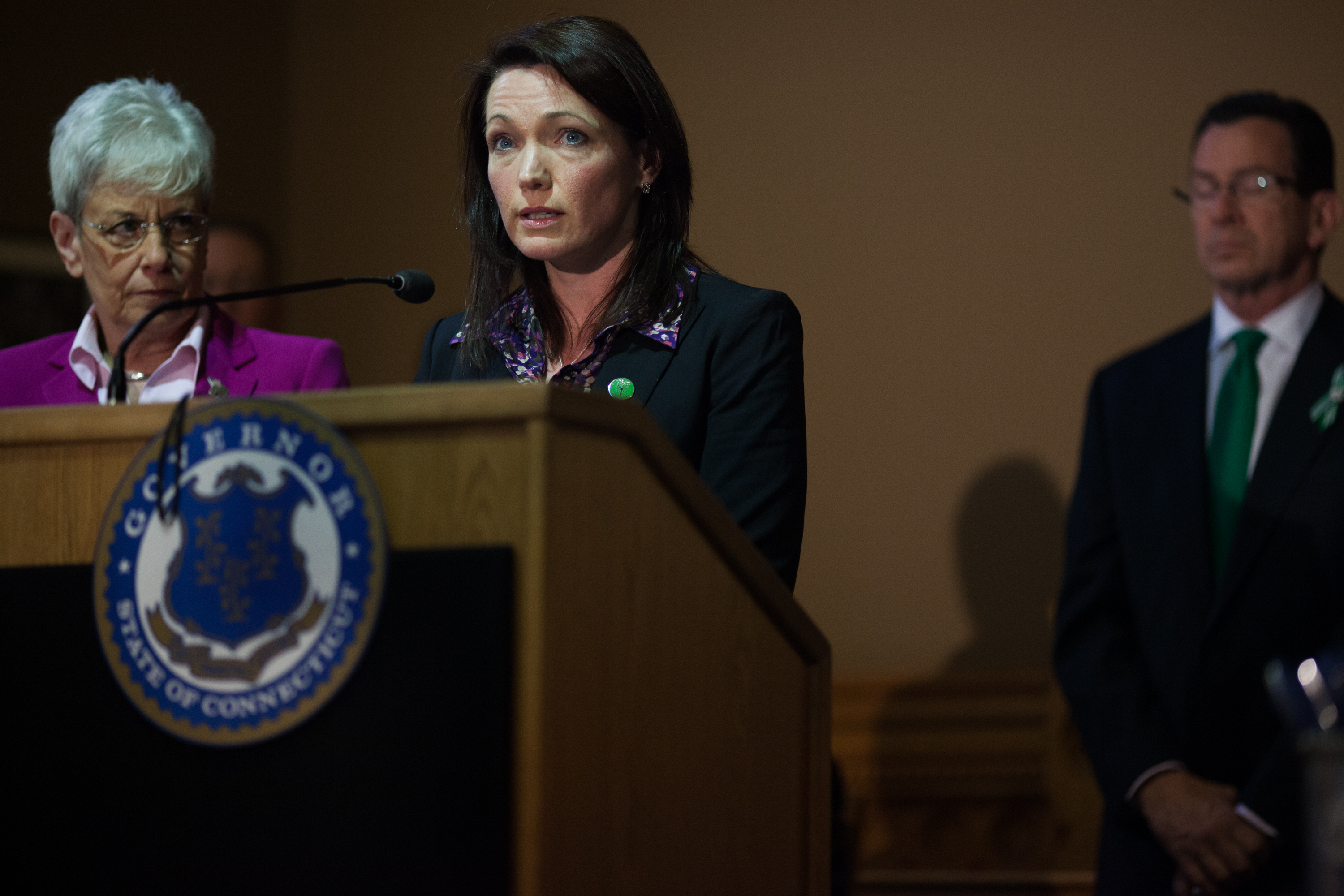 HARTFORD, CT - APRIL 4:  Nicole Hockley (C), a parent of Sandy Hook School shooting victim Dylan Hockley,speaks in the Old Judiciary Room prior to the signing of the historic gun control bill as Connecticut Gov. Dannel Malloy (R) looks on April 4, 2013 in Hartford, Connecticut, After more than 13 hours of debate, the Connecticut General Assembly approved a gun-control bill early April 4, that proponents seen as the toughest-in-the-nation response to the Demember 14, 2012 Newtown school shootings. (Photo by Christopher Capozziello/Getty Images)