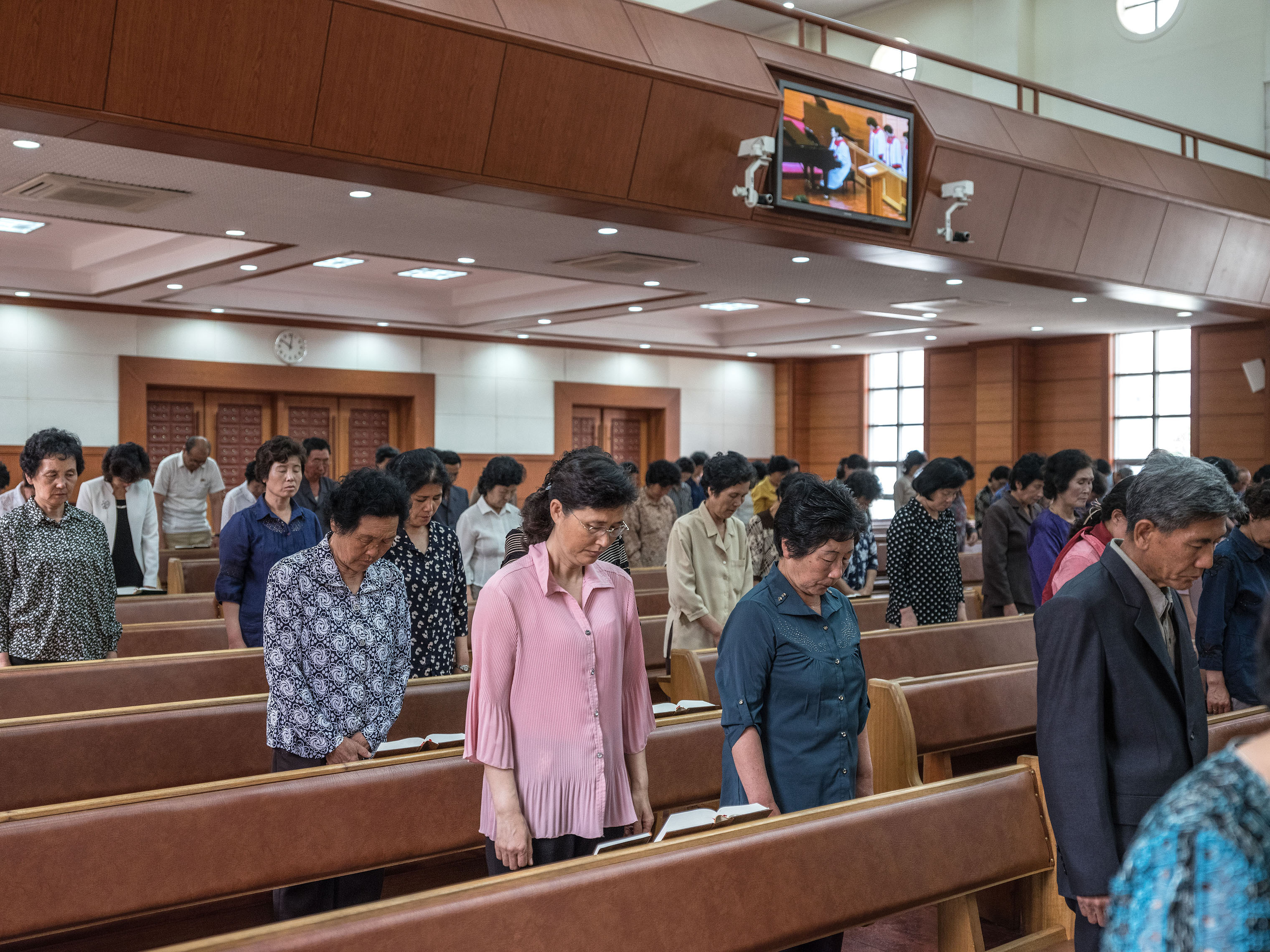 Worshipers pray at Bongsu Church in Pyongyang.