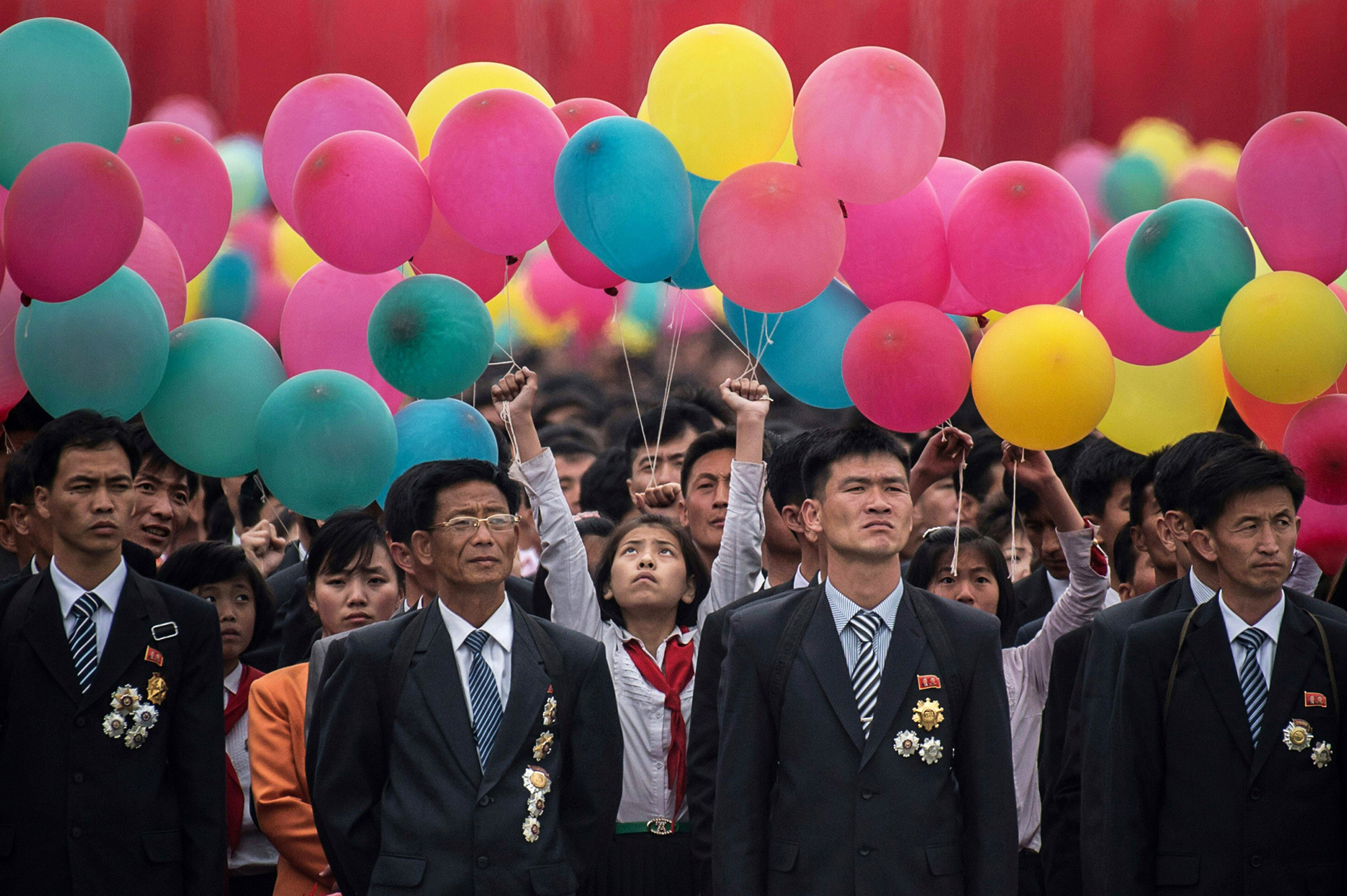 Participants wait to take part in a mass parade marking the end of the 7th Workers Party Congress in Kim Il Sung Square in Pyongyang on May 10, 2016.