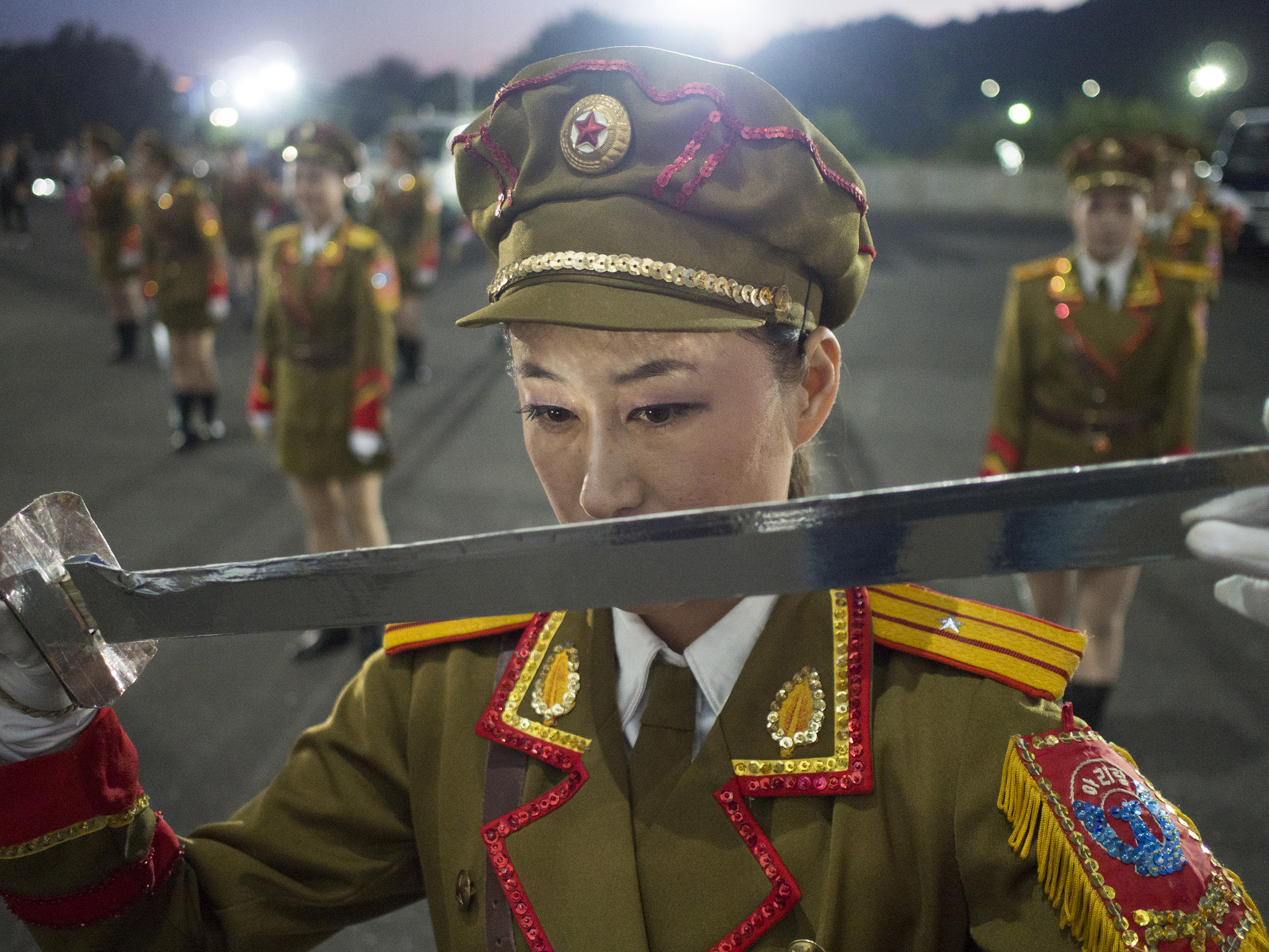 Ri Hyang Yon, 21, a dancer in the Arirang Games, during a practice session in the car park of May Day Stadium in Pyongyang.