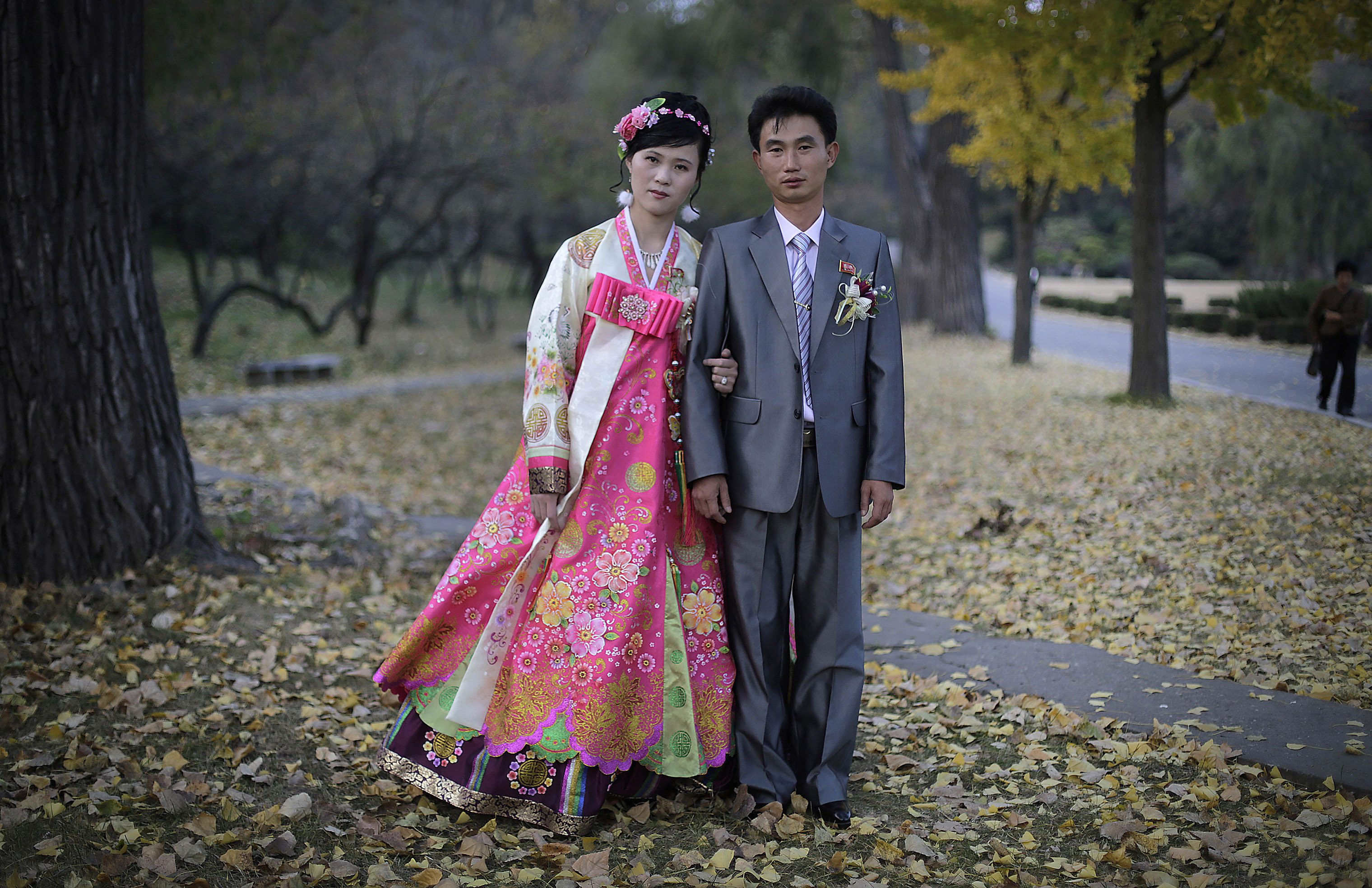 A bride and groom pose for a photograph at the hill where they went to take wedding pictures in Pyongyang on Oct. 25, 2014.