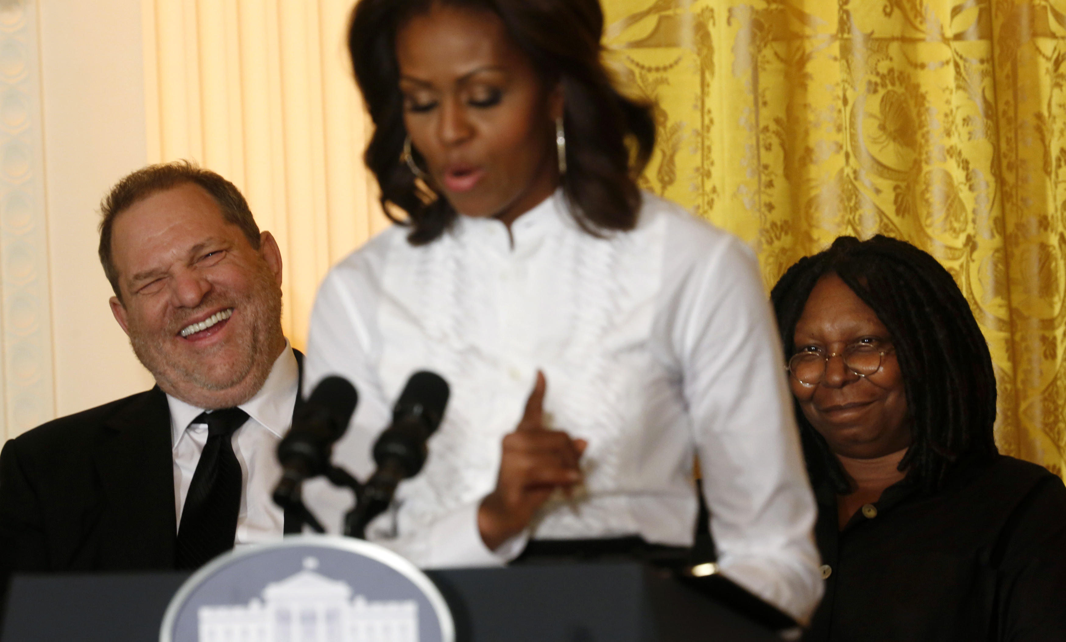 Film producer and studio executive Harvey Weinstein laughs at remarks directed at him by first lady Michelle Obama as she hosts a workshop at the White House for high school students about careers in film in Washington on Nov. 8, 2013.