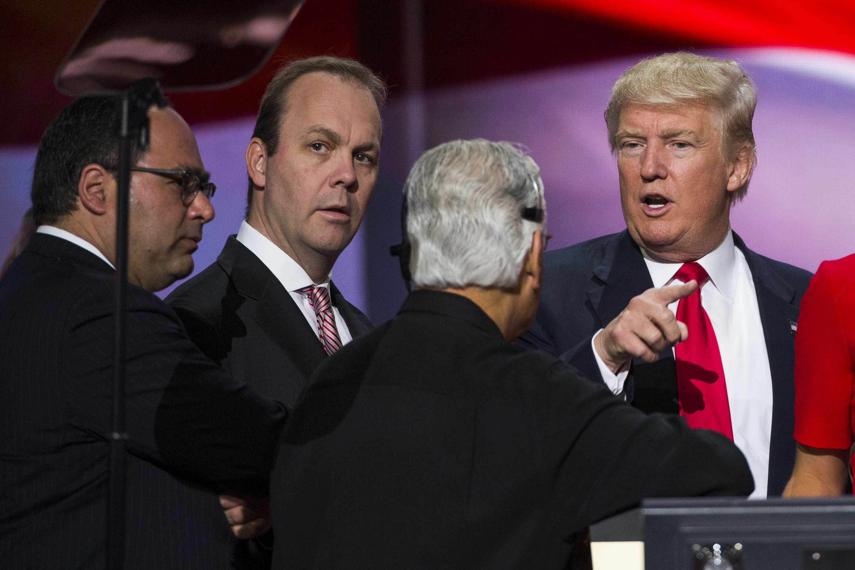 Republican nominee Donald Trump speaks with Rick Gates at the Republican Convention, July 21, 2016 at the Quicken Loans Arena in Cleveland.
