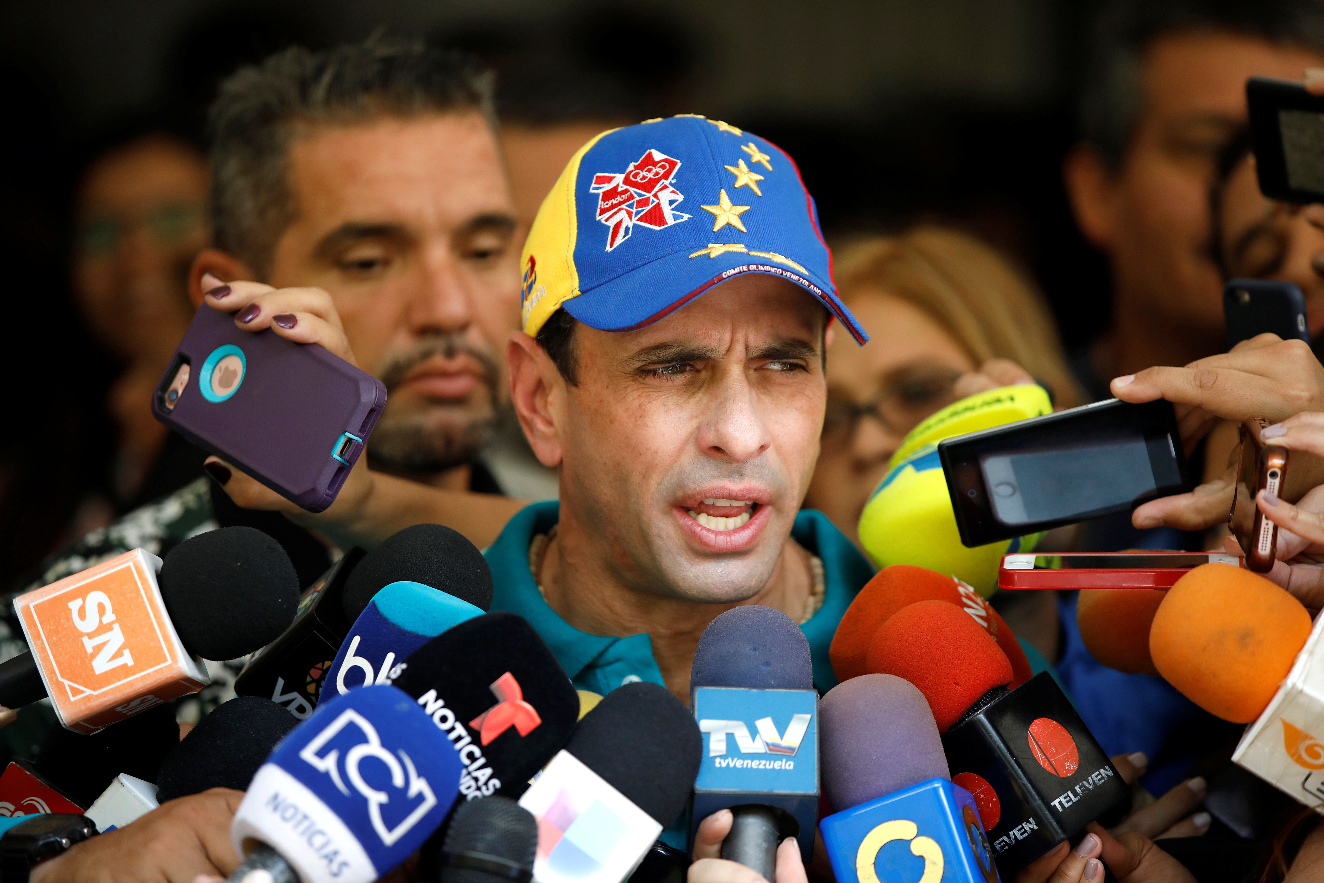 Venezuela's opposition leader Henrique Capriles speaks to the media after casting his vote during nationwide elections for new governors on Oct. 15, 2017.