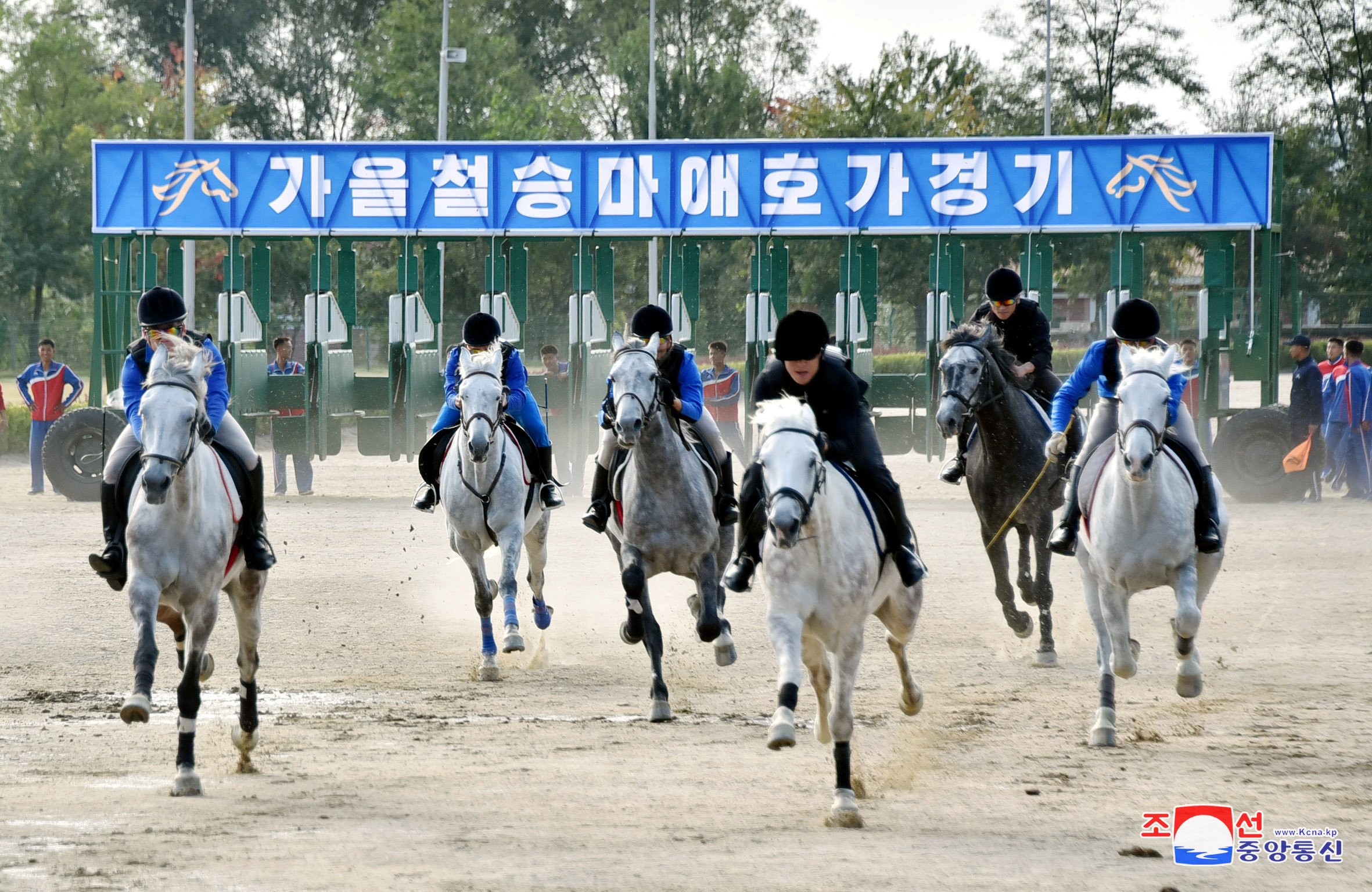 People take part in a horse riding game at the Mirim Equestrian Riding Club in Pyongyang, Oct. 15, 2017, in this picture released by North Korea's Korean Central News Agency (KCNA) in Pyongyang.
