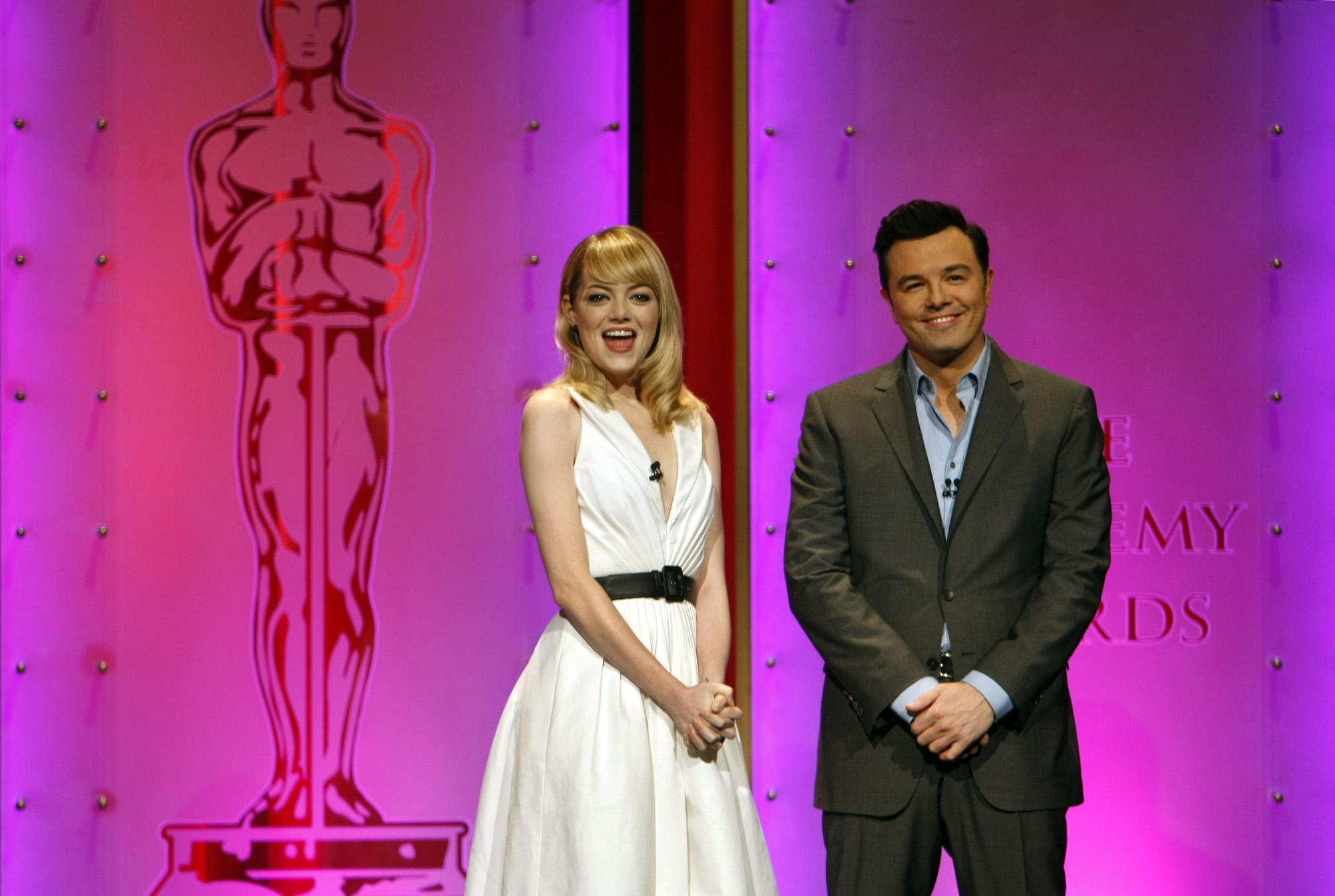 Seth MacFarlane and actress Emma Stone announce the Academy Award nominations in Beverly Hills, CA on Jan. 10, 2013.