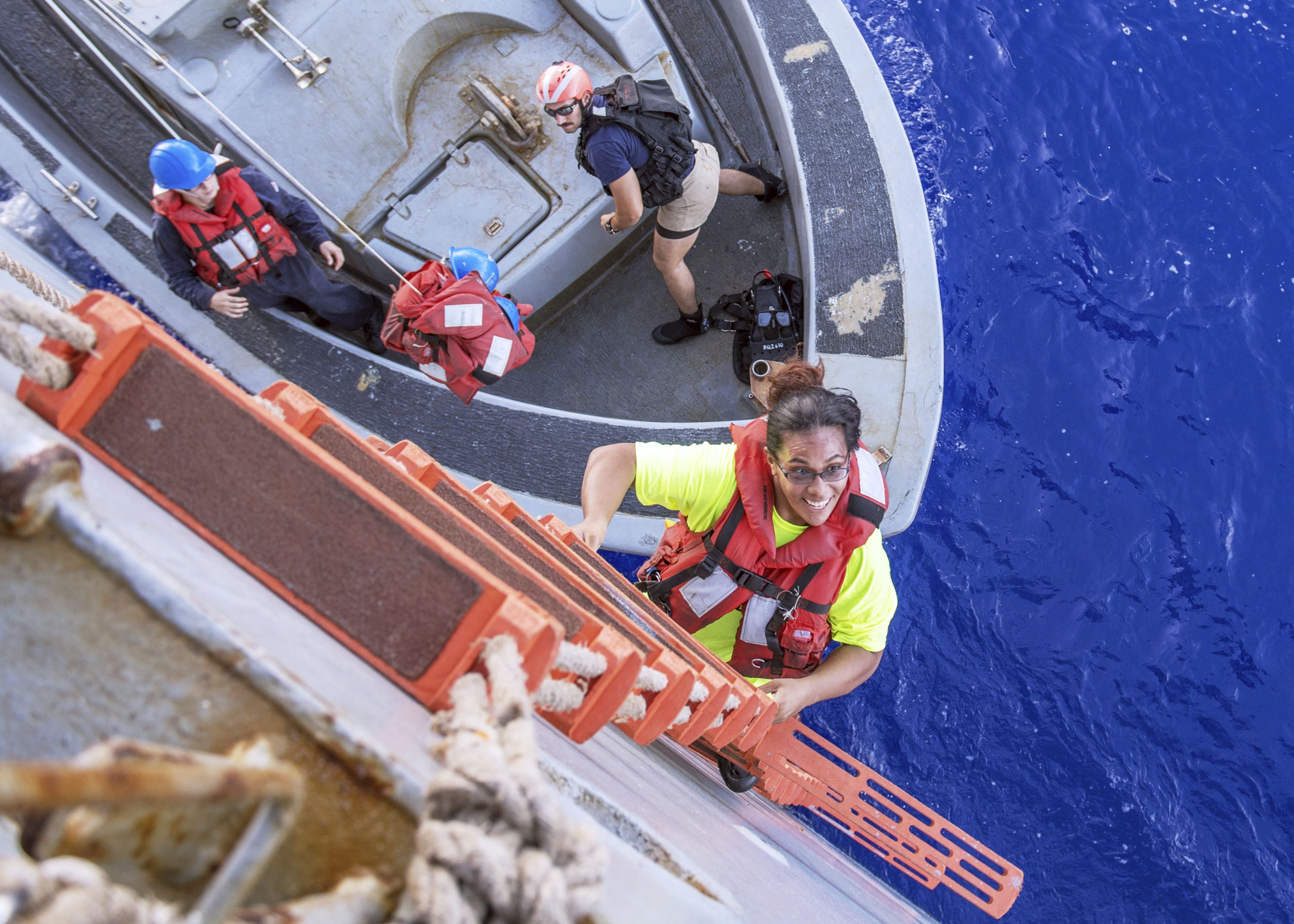 Tasha Fuiaba, an American mariner, climbs the accommodation ladder to board the dock landing ship USS Ashland after the Navy ship rescued two Honolulu women and their dogs after being lost at sea for several months while trying to sail from Hawaii to Tahiti.