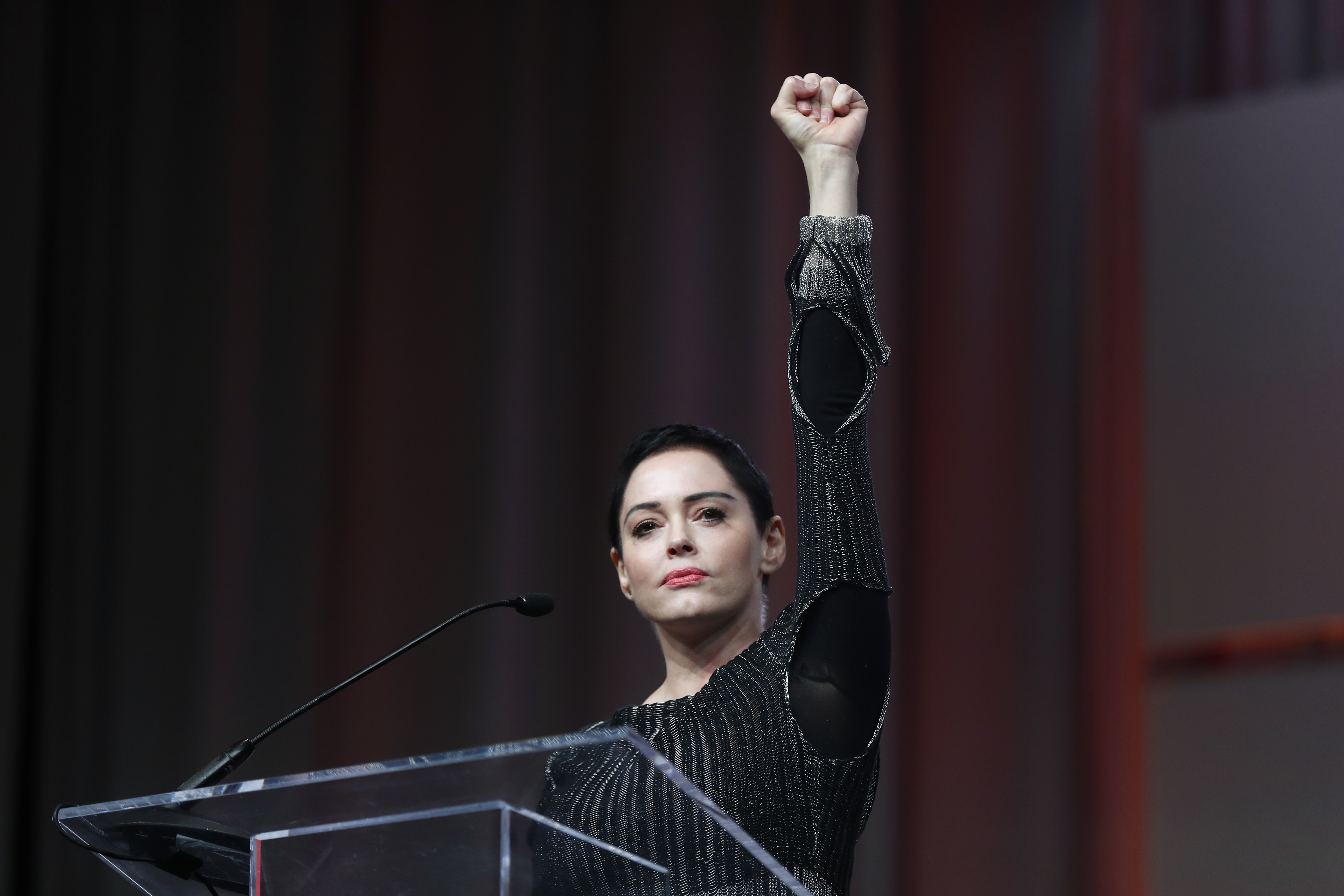Actress Rose McGowan speaks at the inaugural Women's Convention in Detroit on Oct. 27, 2017. McGowan recently went public with her allegation that film company co-founder Harvey Weinstein raped her.