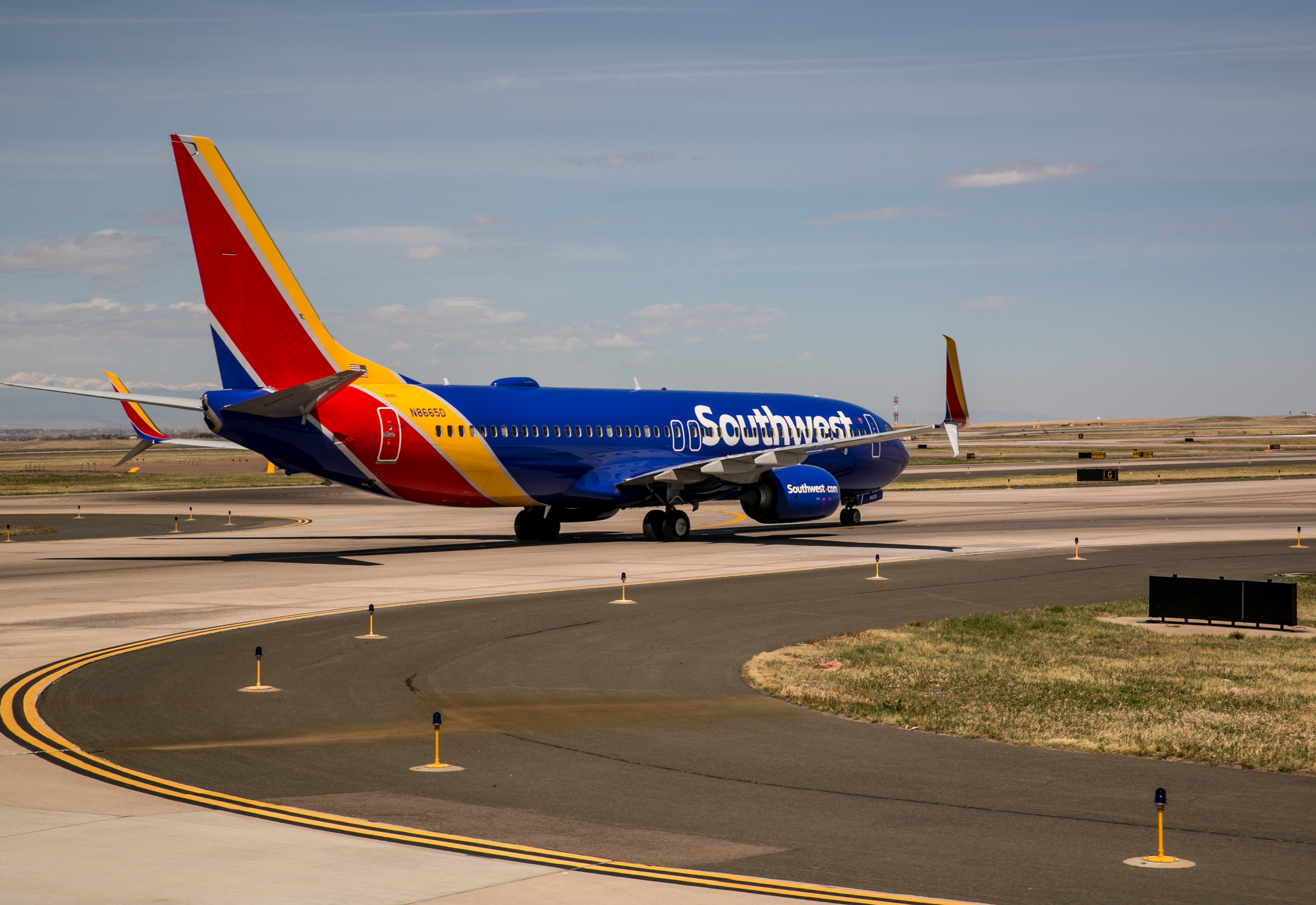 DENVER, CO - APRIL 16:  A Southwest Airlines passenger jet moves off the runway and onto the C terminal at Denver International Airport on April 16, 2017, in Denver, Colorado. Located 25 miles from downtown, Denver International Airport, a United Airlines hub, has become one the largest airport in the United States.  (Photo by George Rose/Getty Images)