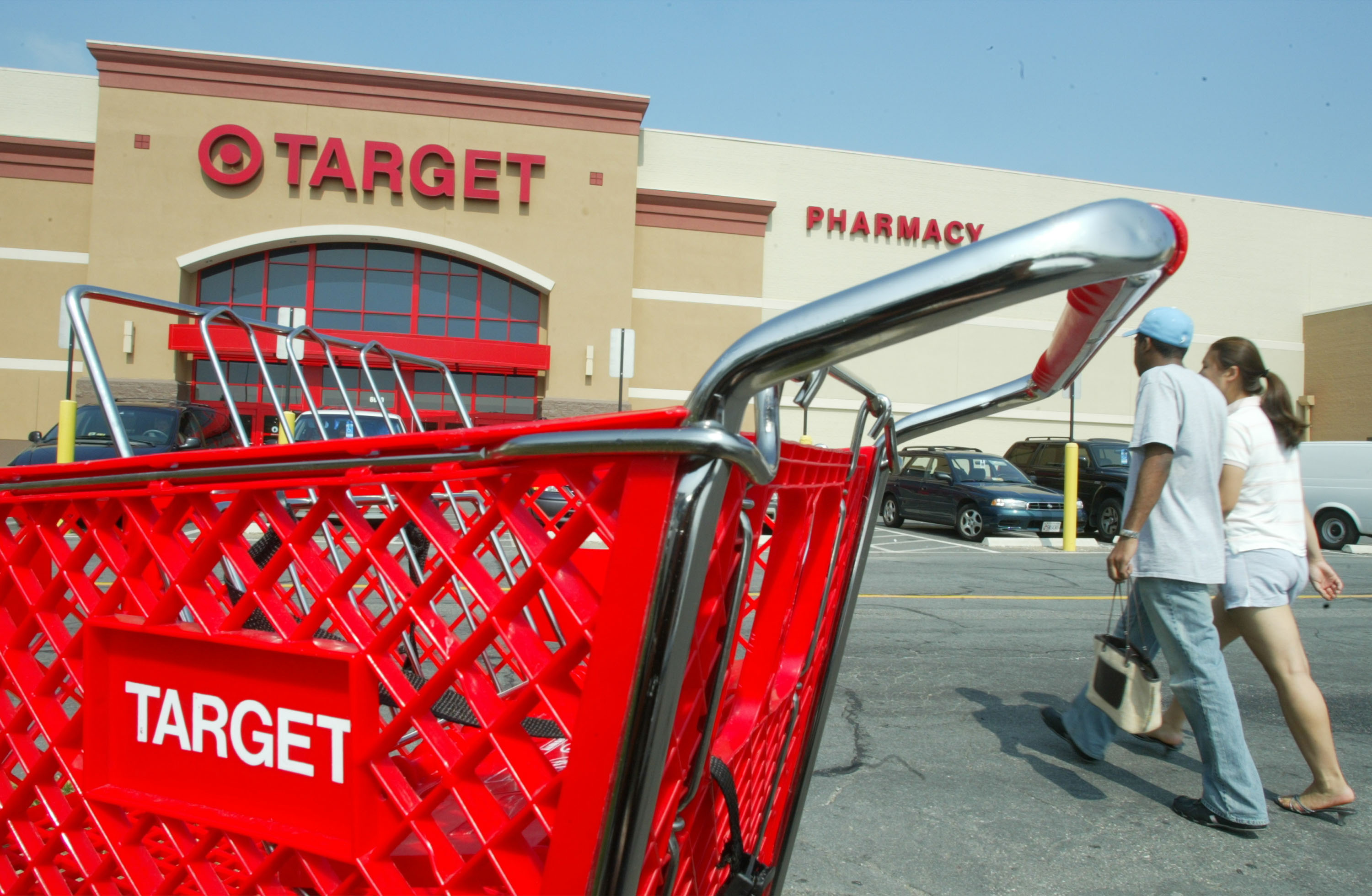 Customers walk outside a Target store August 14, 2003 in Springfield, Virginia.
