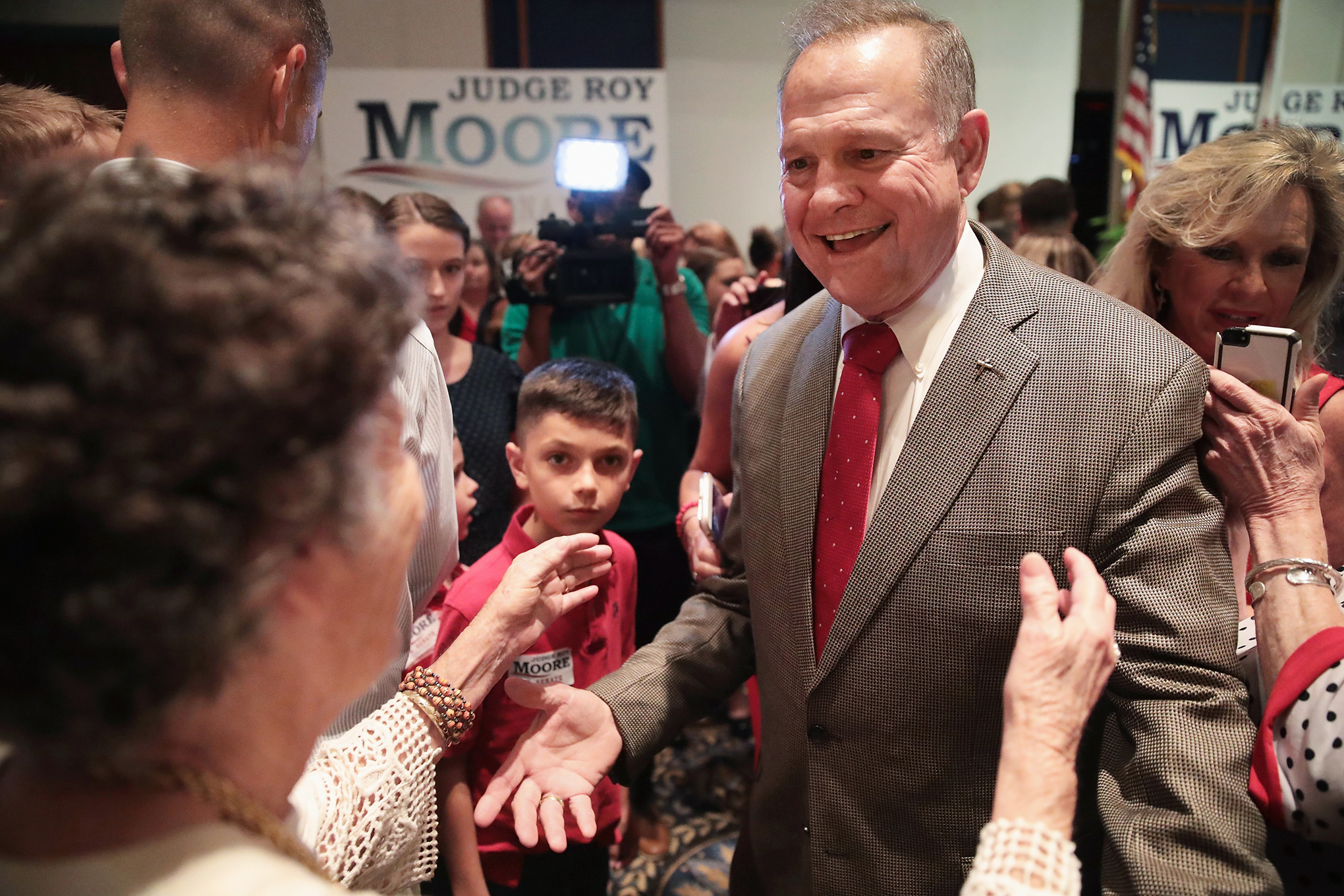 Moore greets supporters on Sept. 26 after winning the Republican primary in the special election for Alabama's open Senate seat