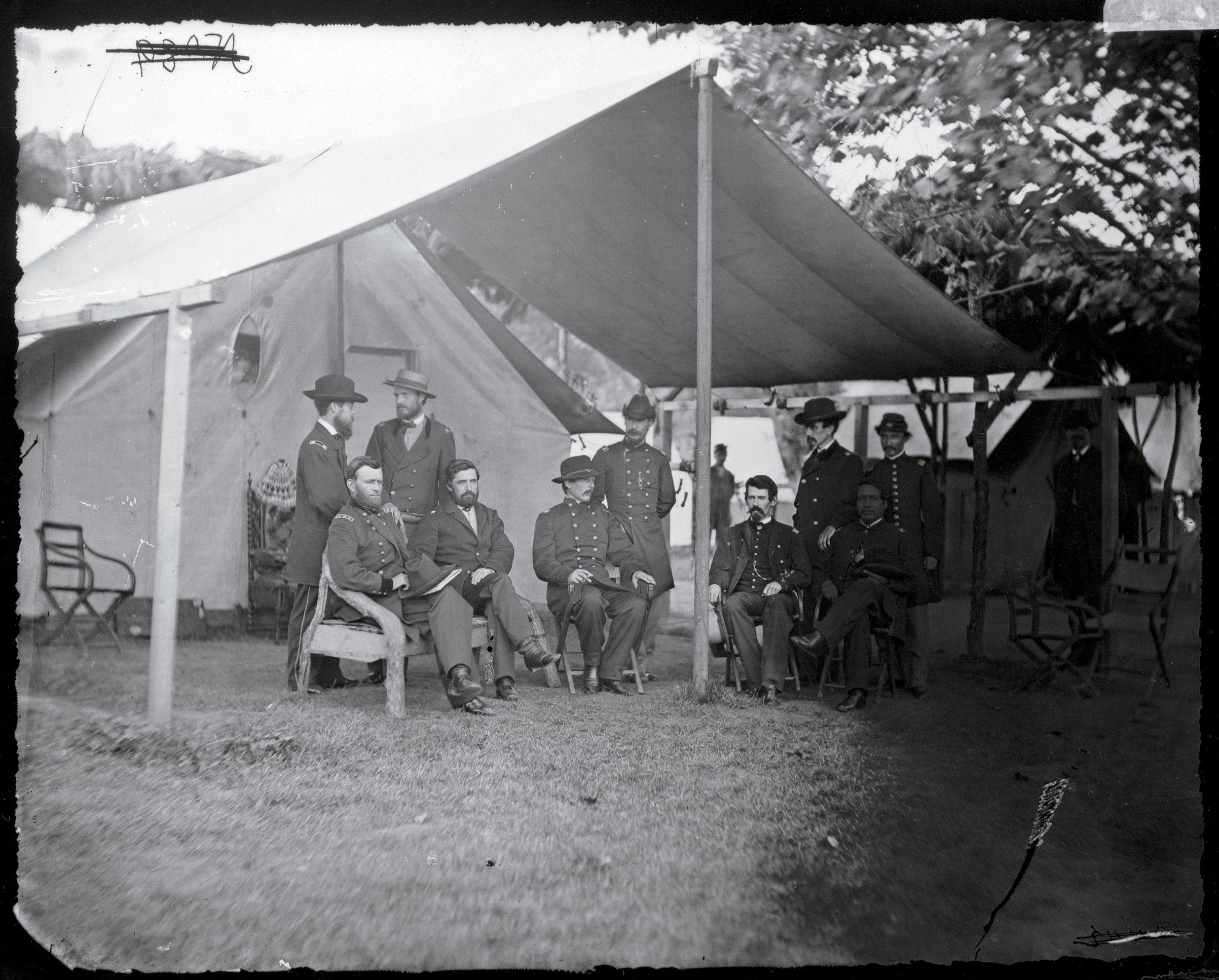 "Chernow calls Grant, seated at far left, surrounded by his military staff, ""a man really free of hate"""