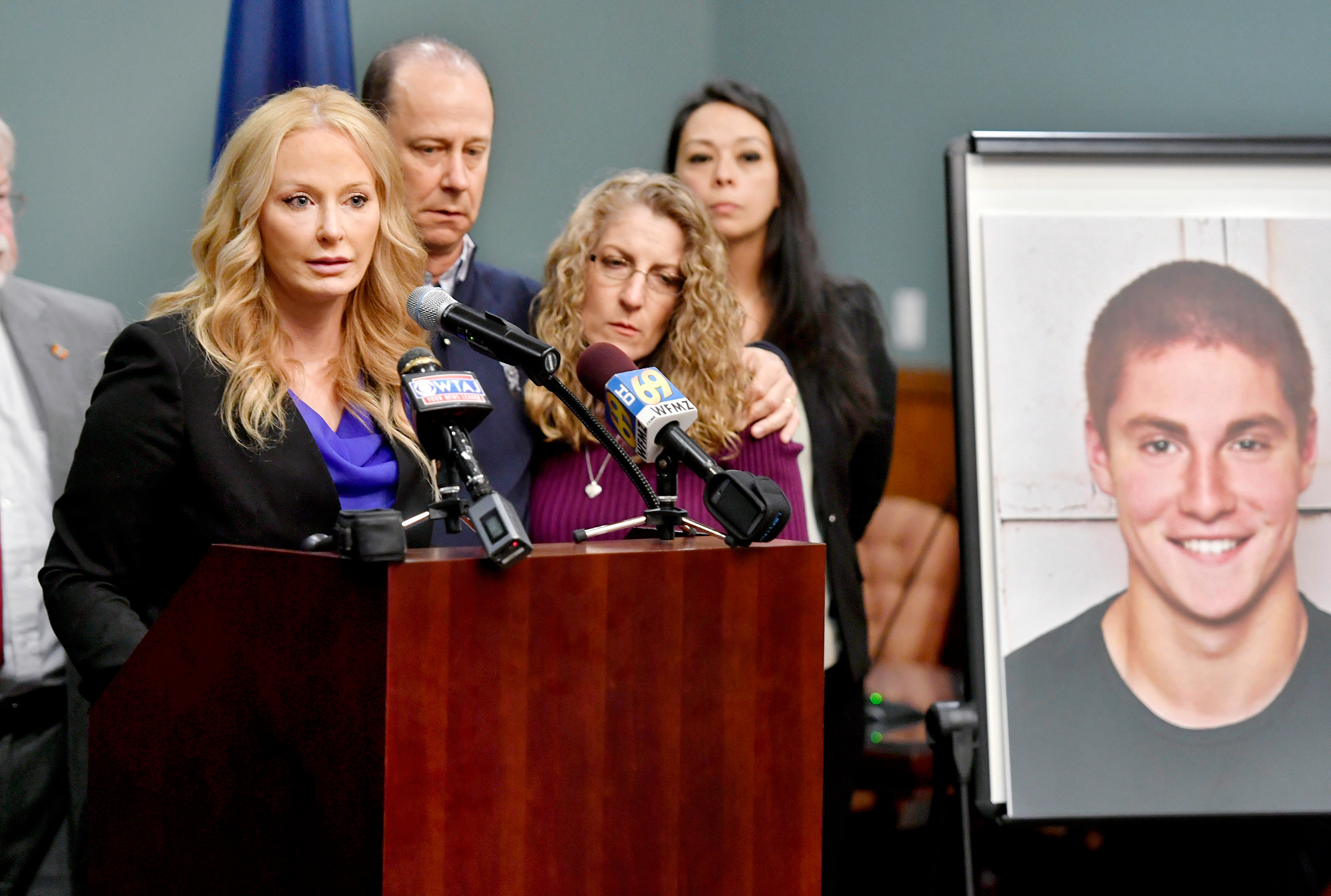 Centre County District Attorney Stacy Parks Miller, left, stands with Tim Piazza's parents on May 5 to announce the results of an investigation into his death