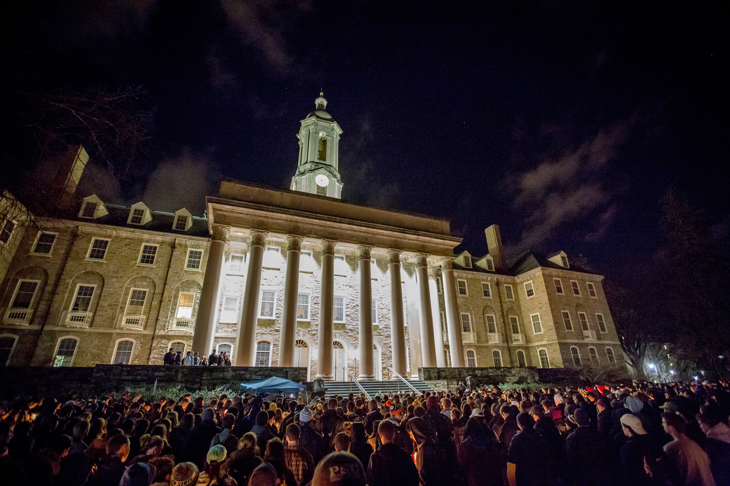 Students at Penn State gather for a candlelight vigil on Feb. 12, following Piazza's death